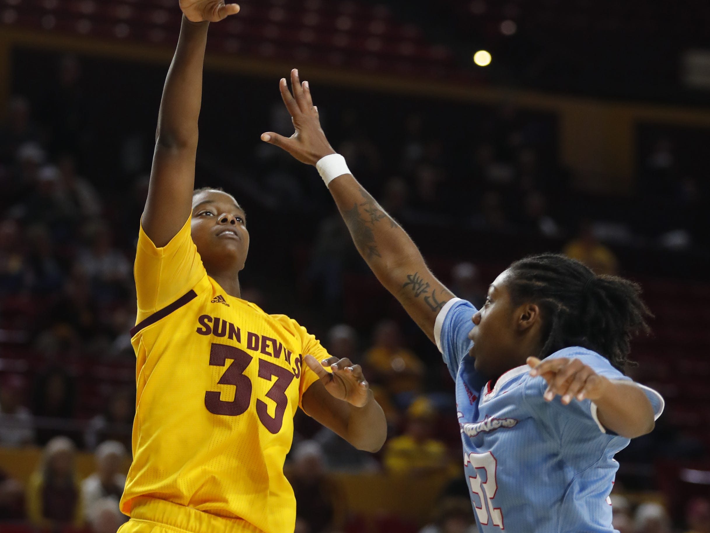 ASU's Charnea Johnson-Chapman (33) scores over Louisiana Tech's Zhanae Whitney (32) during the second half at Wells Fargo Arena in Tempe, Ariz. on November 30, 2018.