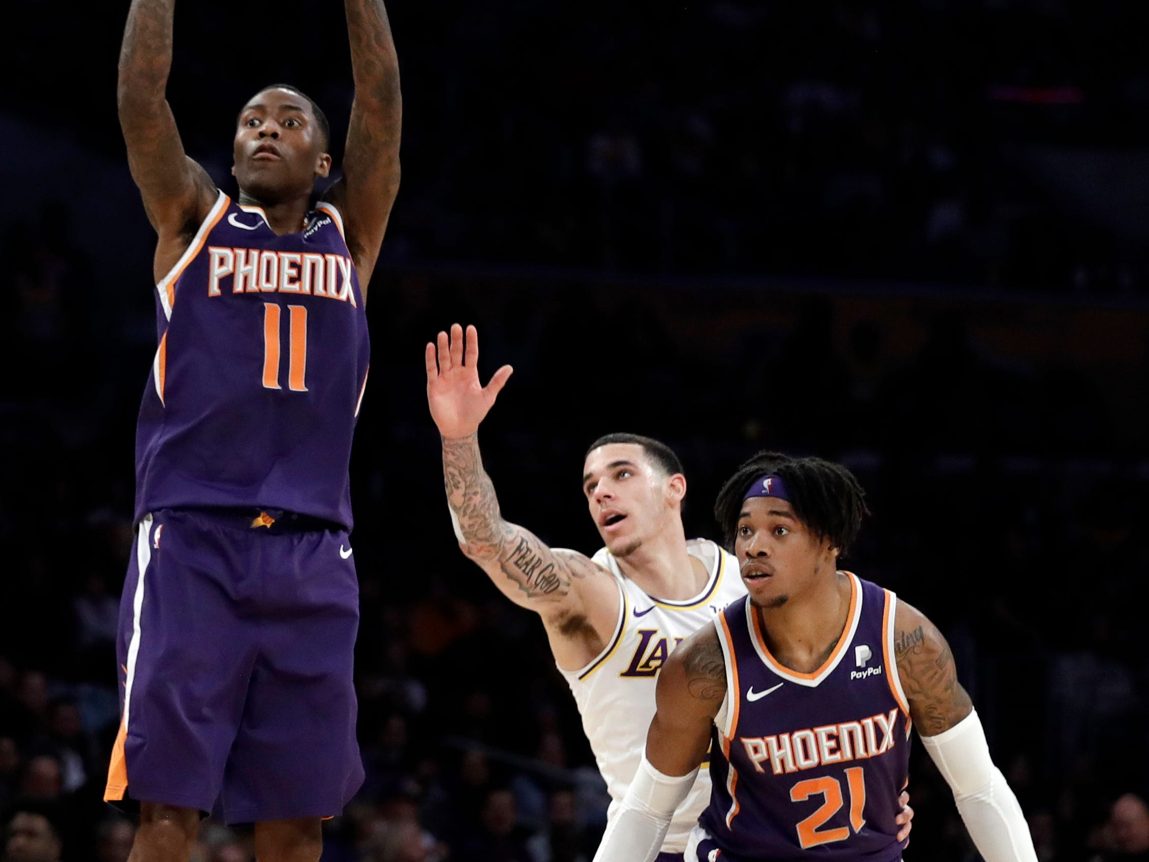 Phoenix Suns' Jamal Crawford (11) shoots past Los Angeles Lakers' Lonzo Ball, center, and teammate Richaun Holmes (21) during the first half of an NBA basketball game Sunday, Dec. 2, 2018, in Los Angeles. (AP Photo/Marcio Jose Sanchez)