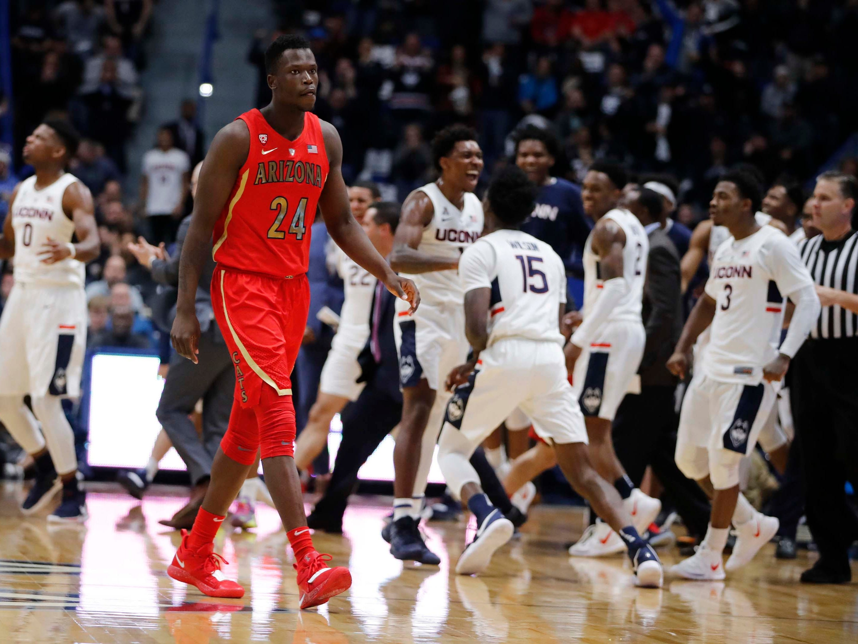 Dec 2, 2018: Arizona Wildcats guard Emmanuel Akot (24) returns to the bench during a break in the action against the Connecticut Huskies in the first half at XL Center.