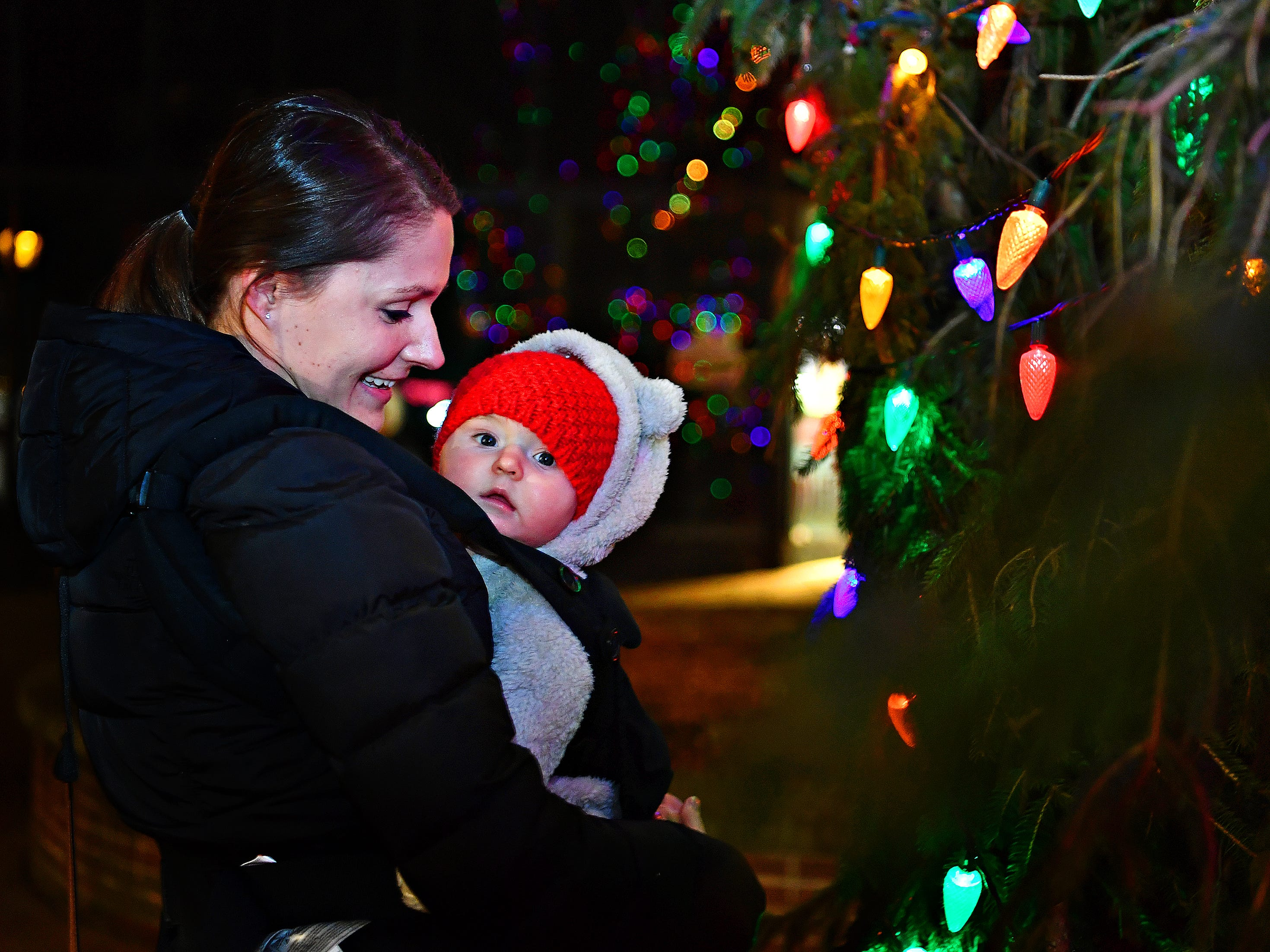 Jenny Statella, of York Township, holds 5-month-old Wylie Statella following the tree lighting during Light Up York in York City, Saturday, Dec. 1, 2018. Dawn J. Sagert photo