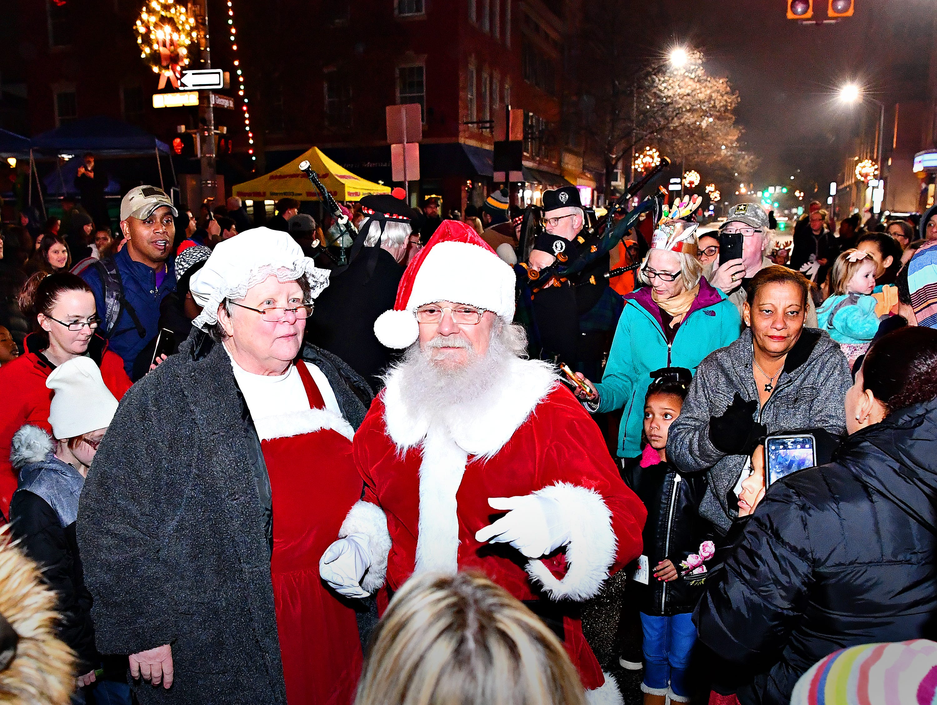 Santa, right, and Mrs. Claus arrive during Light Up York in York City, Saturday, Dec. 1, 2018. Dawn J. Sagert photo