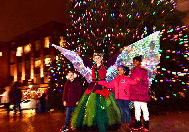 Krystal Younglove, of York City, poses with children for photos during Light Up York in York City, Saturday, Dec. 1, 2018. Dawn J. Sagert photo