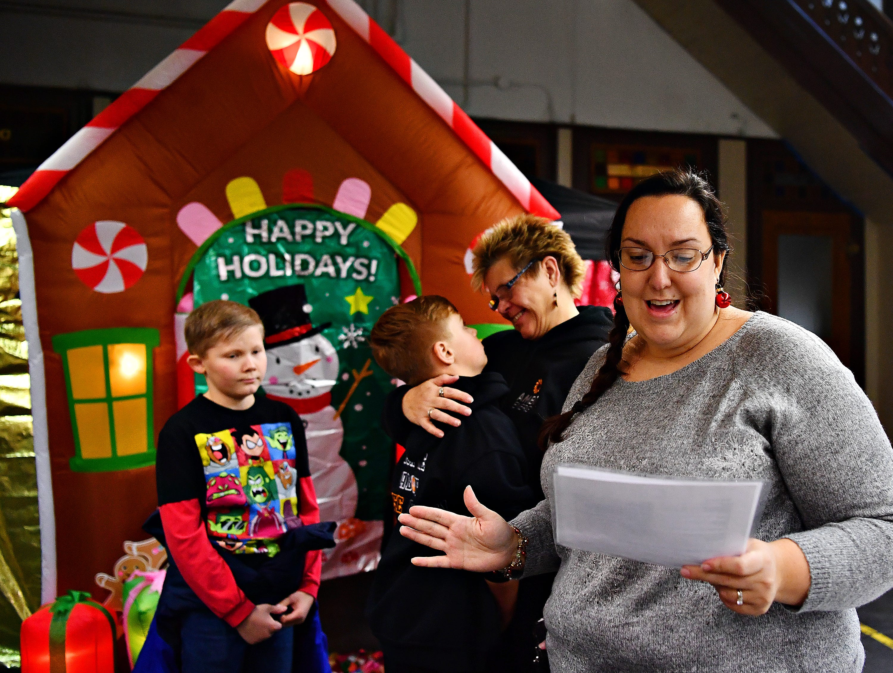Erica Delp, back right, with Atomic Bounce, reads instructions to a group before they enter the Gingerbread-themed Escape Room at Rex/Laurel Fire Station during Light Up York festivities in York City, Saturday, Dec. 1, 2018. Dawn J. Sagert photo