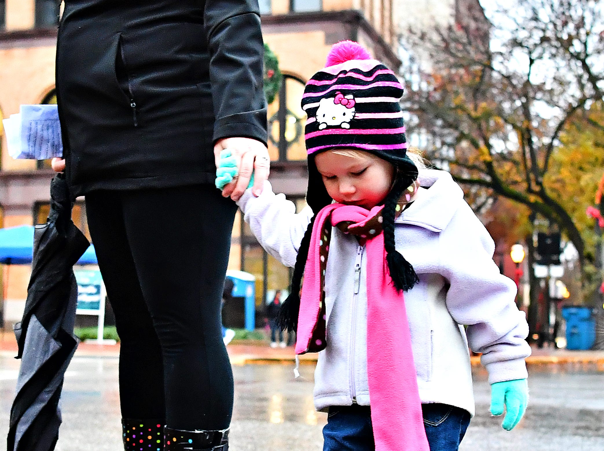 A child finds a puddle during Light Up York in York City, Saturday, Dec. 1, 2018. Dawn J. Sagert photo