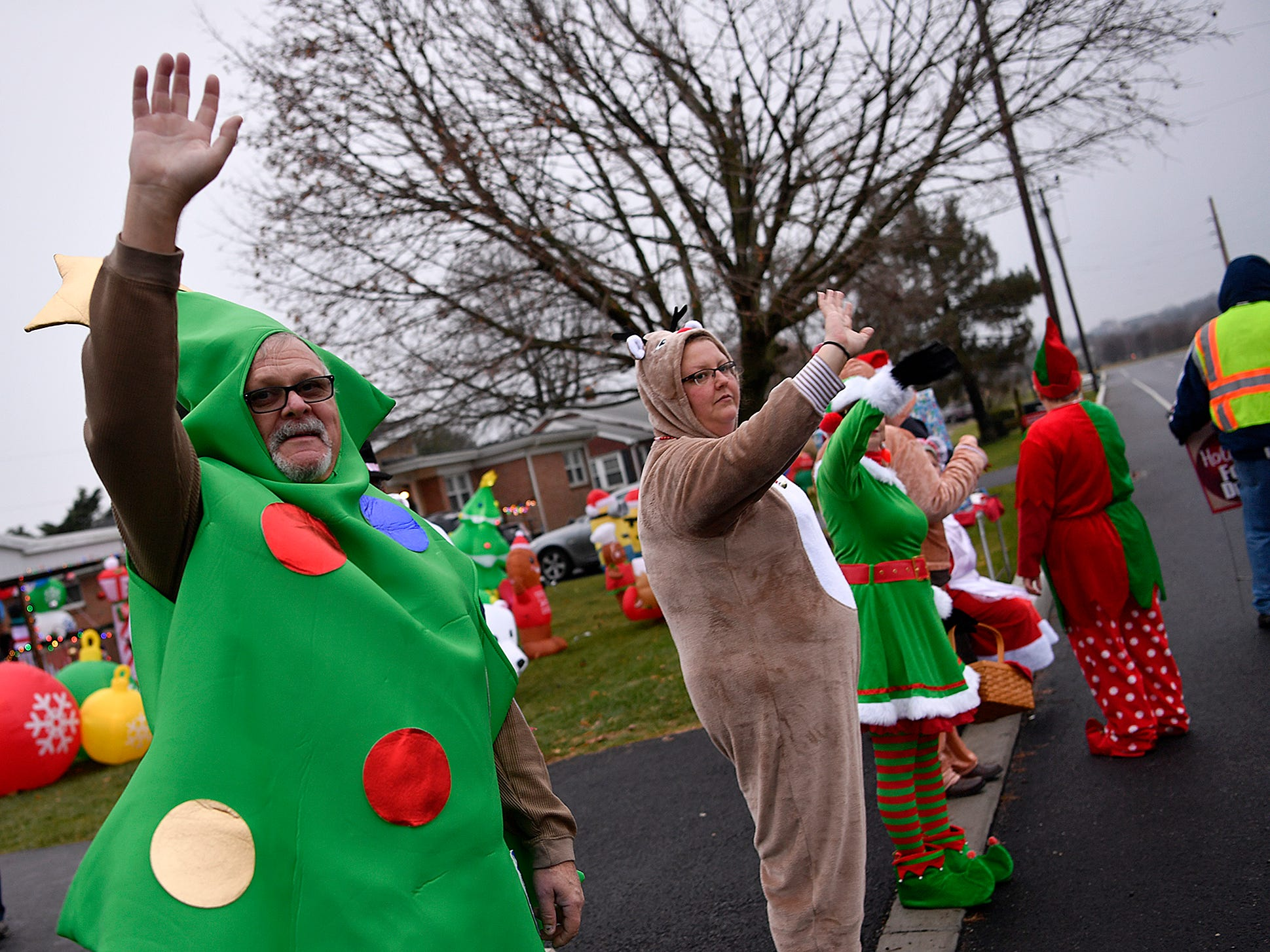 Lee Myers, left, and his family share their holiday spirit while collecting canned goods in front of their home on Loucks Road in West Manchester Township for donation to local food banks, Sunday, December 2, 2018.