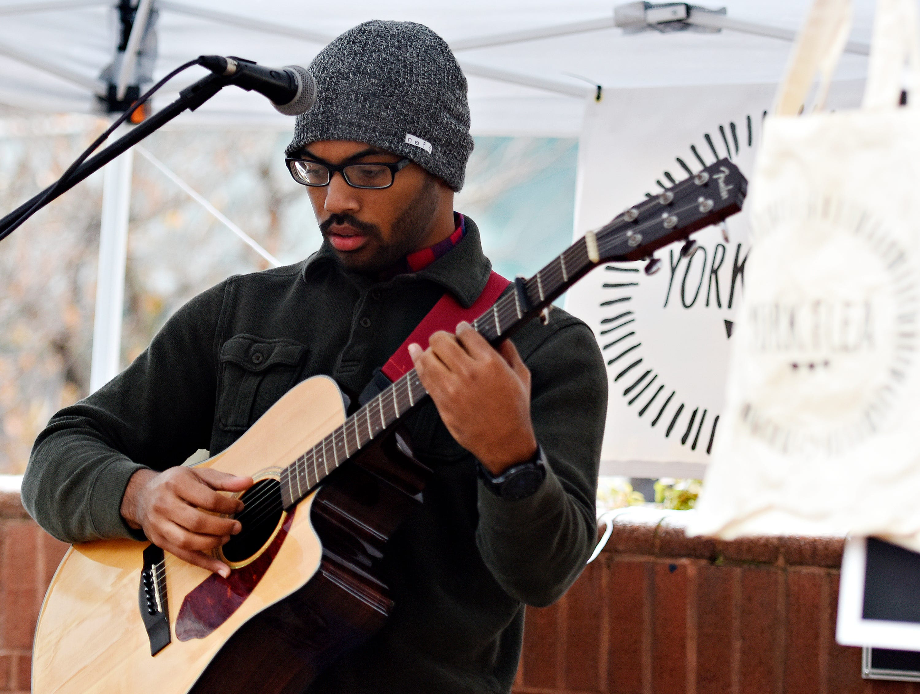 "Eric ""Devix"" Torres performs during York Flea Light in York City, Saturday, Dec. 1, 2018. Dawn J. Sagert photo"