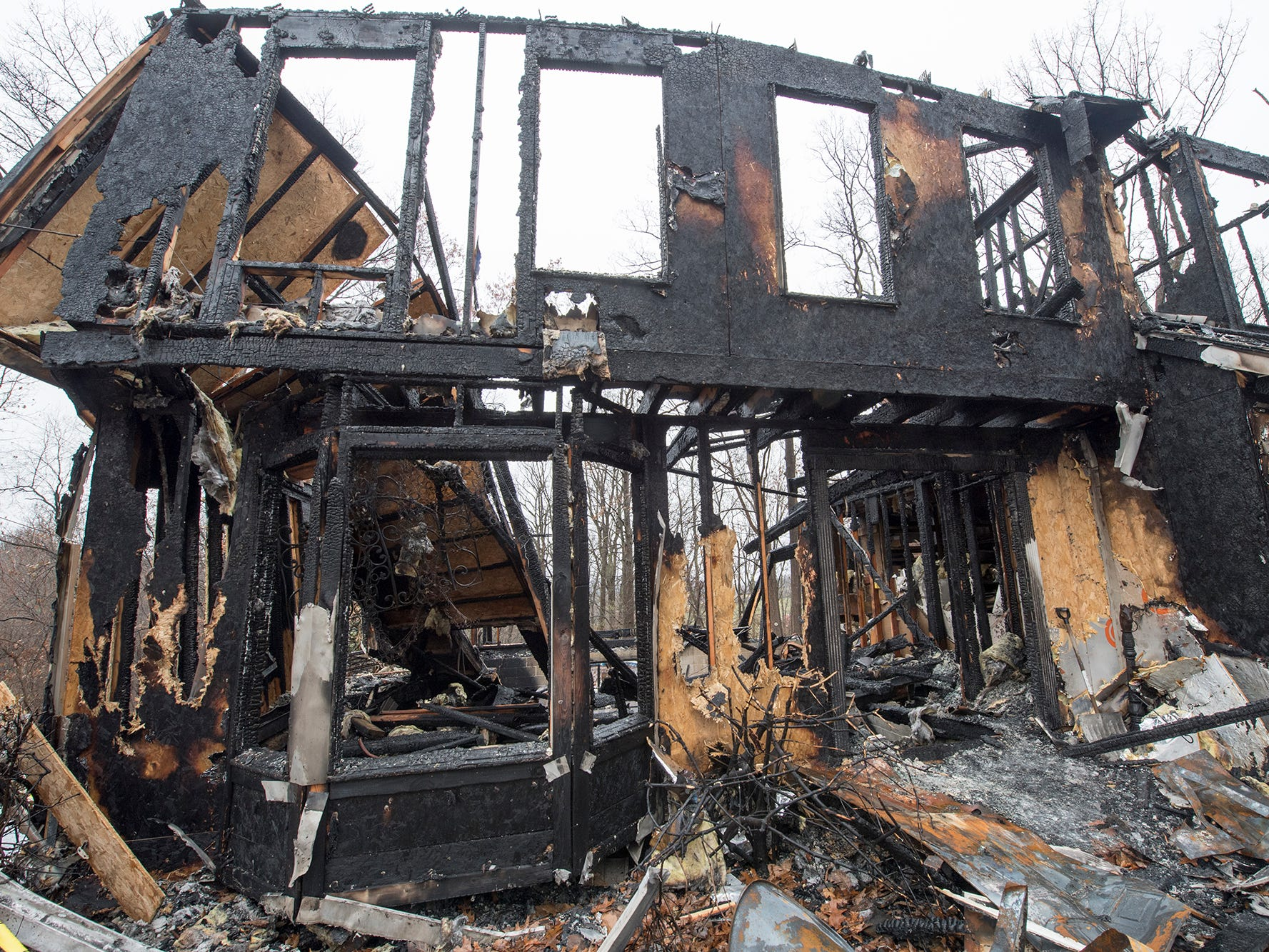 The front of Melissa Herren's home with the front doorway in the bottom center that helped guide her to daylight during the fire.