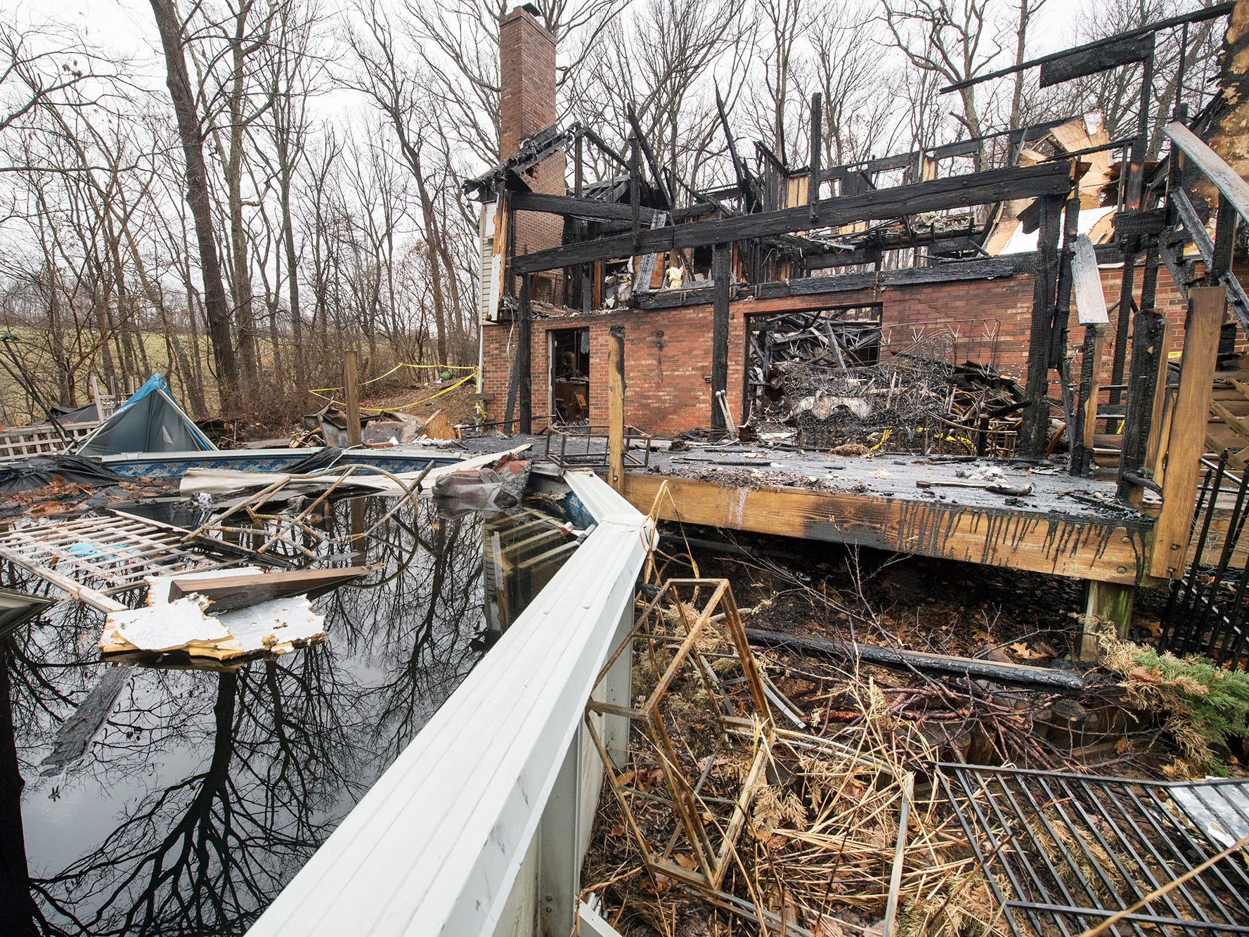 The back of the Shrewsbury home, on Sunday December 2, 2018, once had a two tier deck overlooking the pool.
