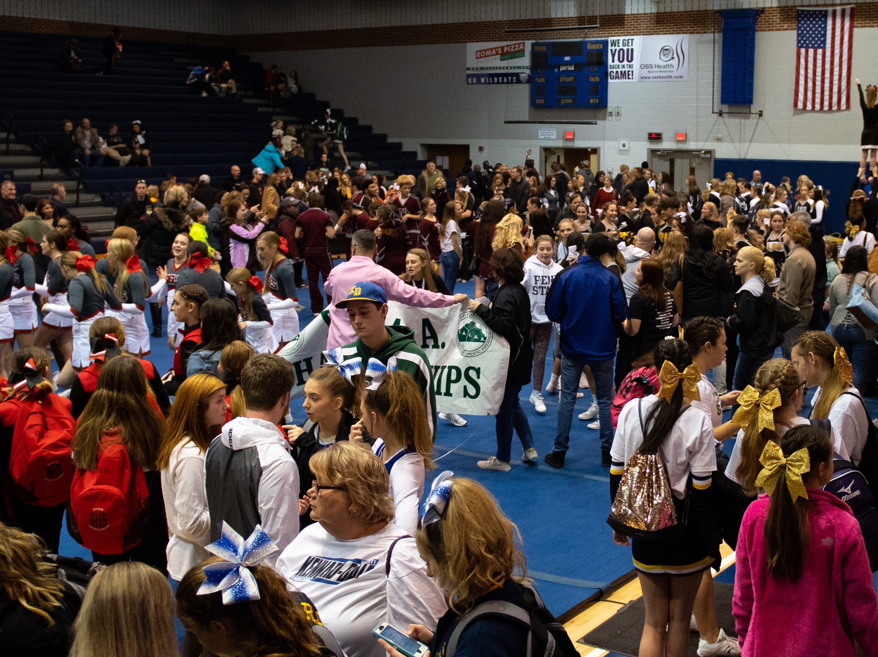 After the competition, parents, players and coaches filled the mat.