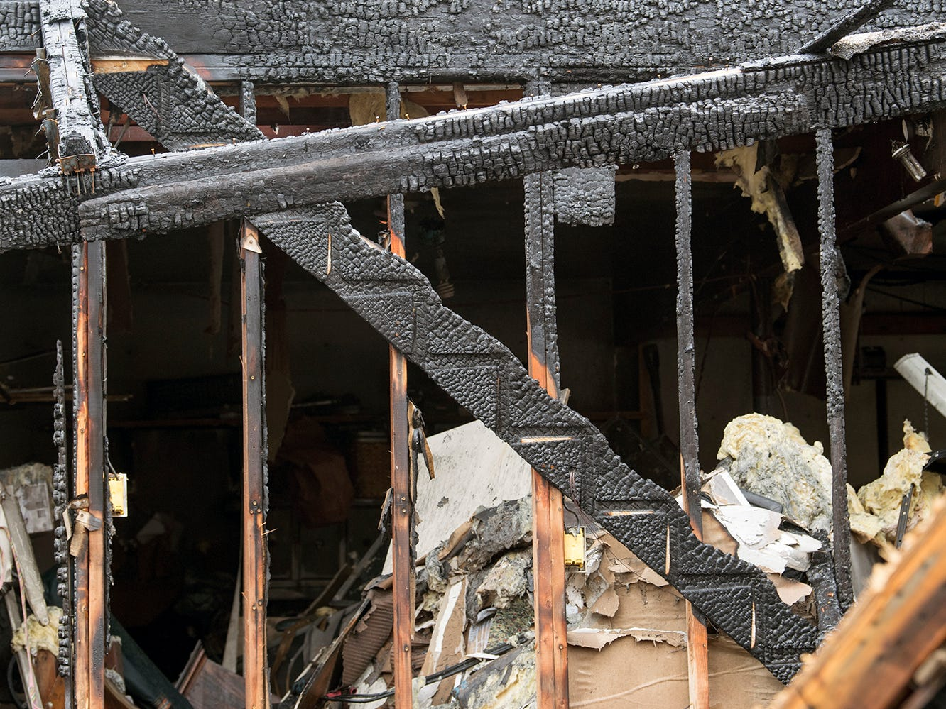 The remains of a staircase that Melissa Herren ran up to find her dogs in the early stages of the fire in Shrewsbury Township on Sunday December 2, 2018.