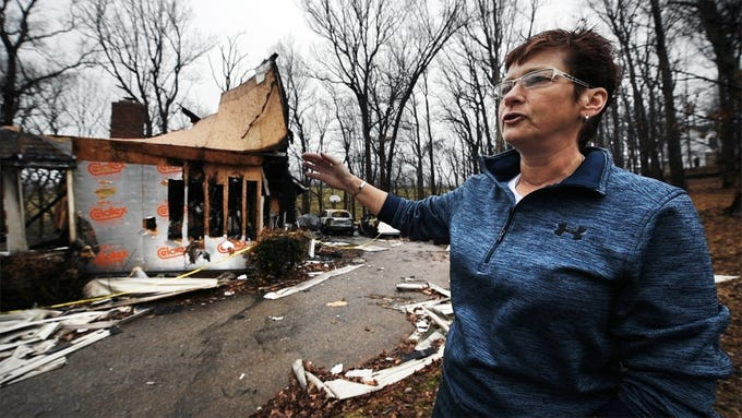 Michelle Herren, the twin sister of Melissa Herren, who was severely burned during the fire, talks about the moments when her sister tried to go back into the house to save her dogs, at the scene of the Shrewsbury Township fire on Sunday December 2, 2018.