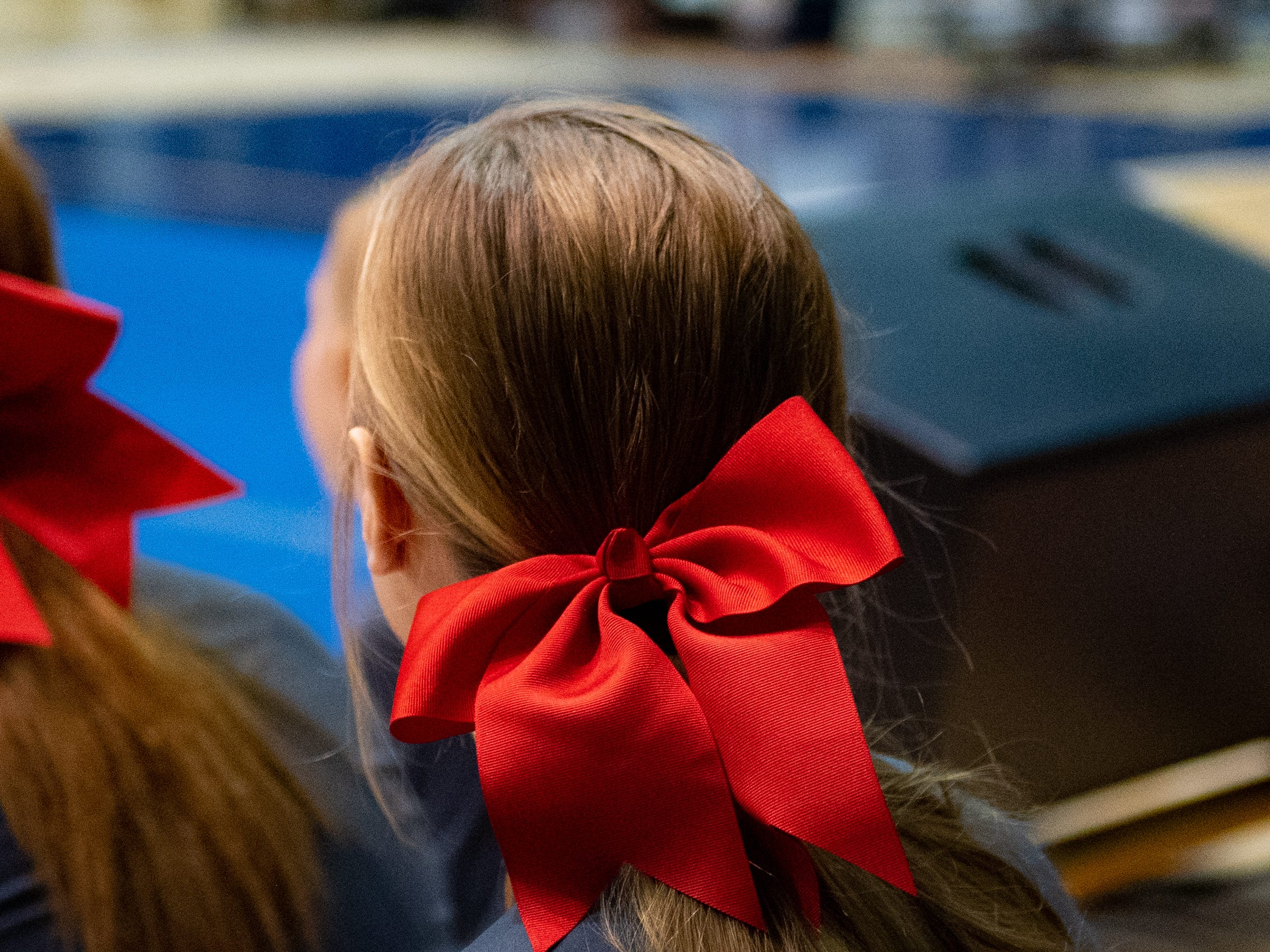 Athletes wear bows in their hair during the YAIAA competitive spirit championships at Dallastown High School, Saturday, December 1, 2018. Dover won the small-varsity division and Red Lion won the coed division.