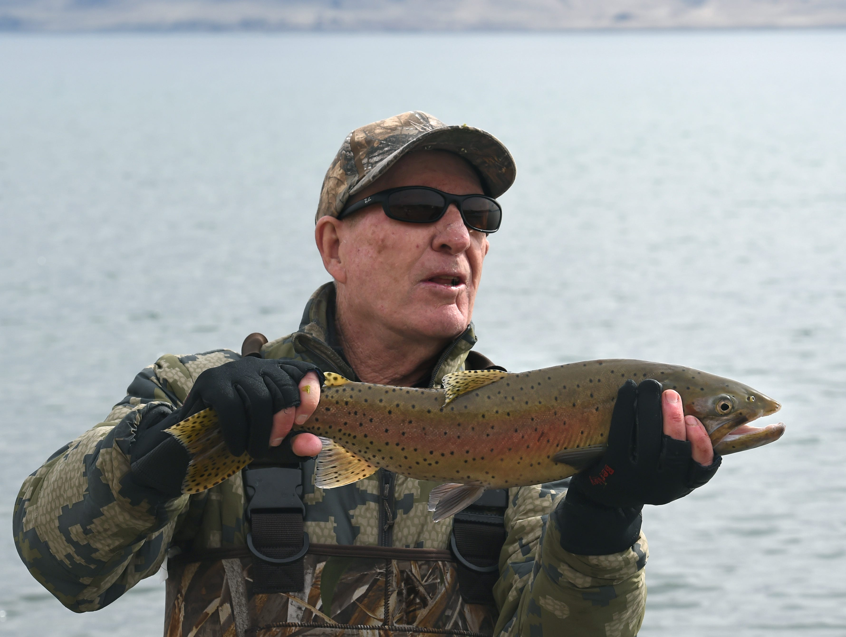 Joe Carolla of Reno poses for his friend to take a photo of him with the Cutthroat Trout he caught at Pyramid Lake this fall.