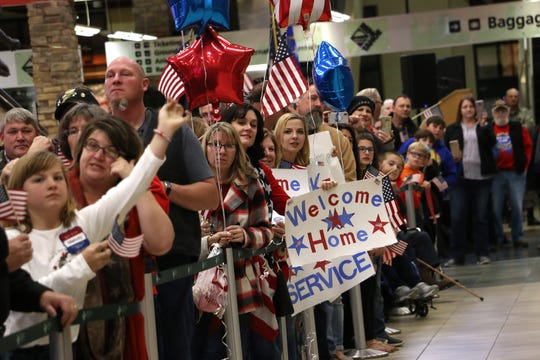 Supporters wait to welcome home local veterans and Gold Star families from their Honor Flight at the Reno-Tahoe International Airport on Dec. 1, 2018.