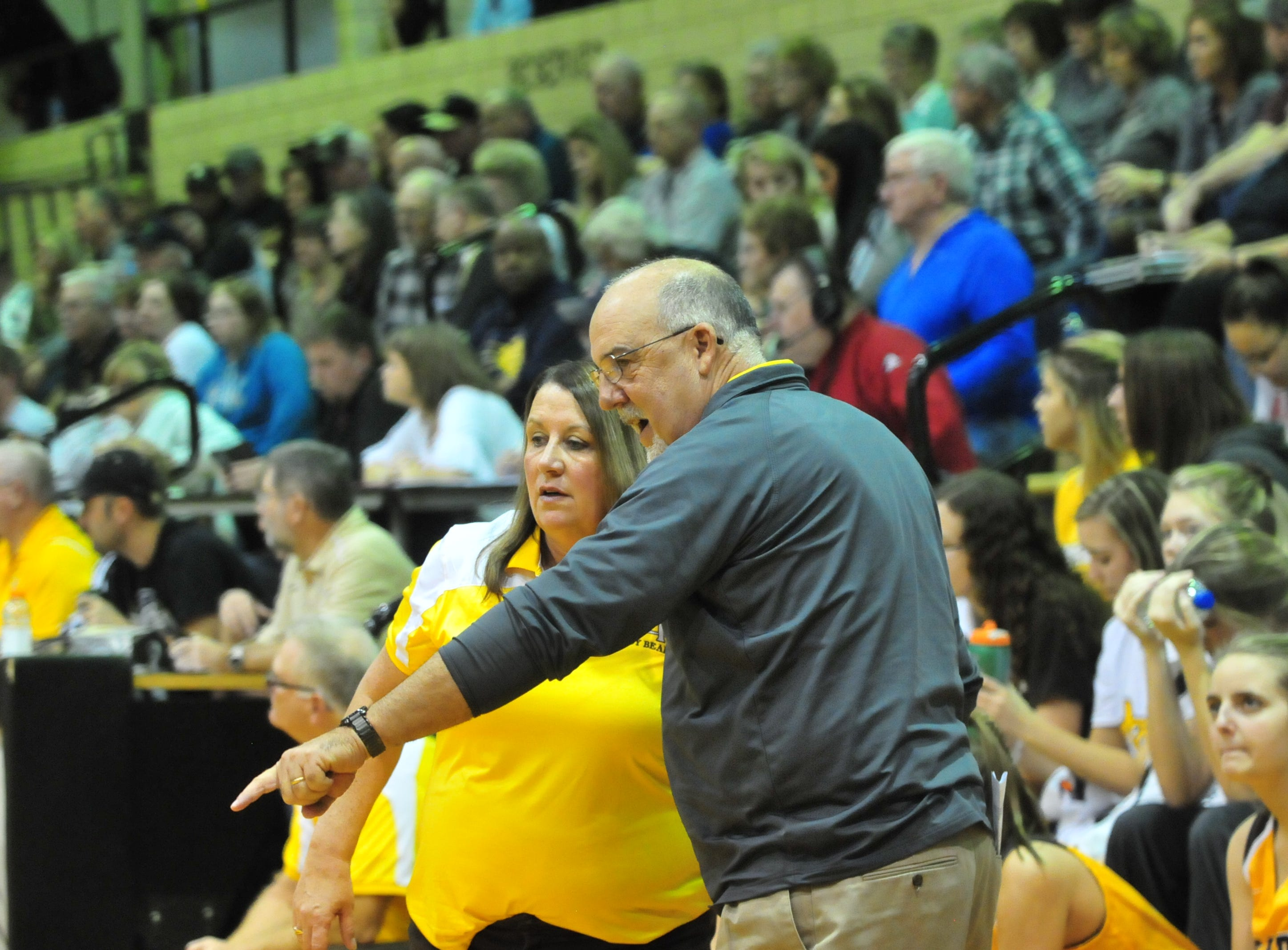 Monroe Central coaches talk during Winchester's 64-39 girls basketball win over Monroe Central Saturday, Dec. 1, 2018 at Winchester Fieldhouse.