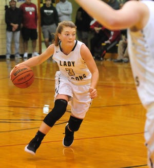 Winchester girls basketball player Becca Chamberlin moves the ball during Winchester's 64-39girls basketball win over Monroe Central Saturday, Dec. 1, 2018 at Winchester Fieldhouse.