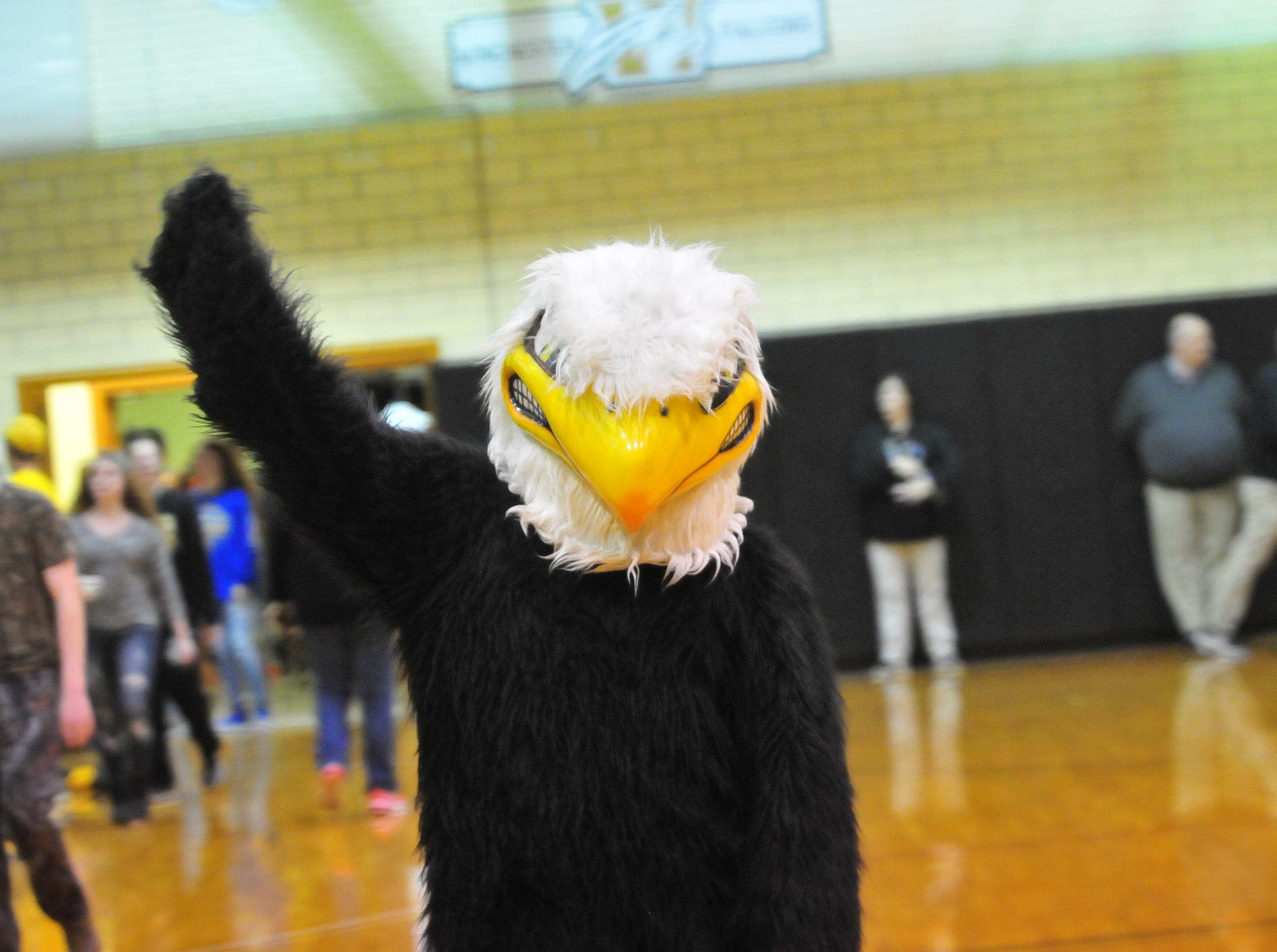 Winchester's Falcon mascot dances during Winchester's 64-39 girls basketball win over Monroe Central Saturday, Dec. 1, 2018 at Winchester Fieldhouse.