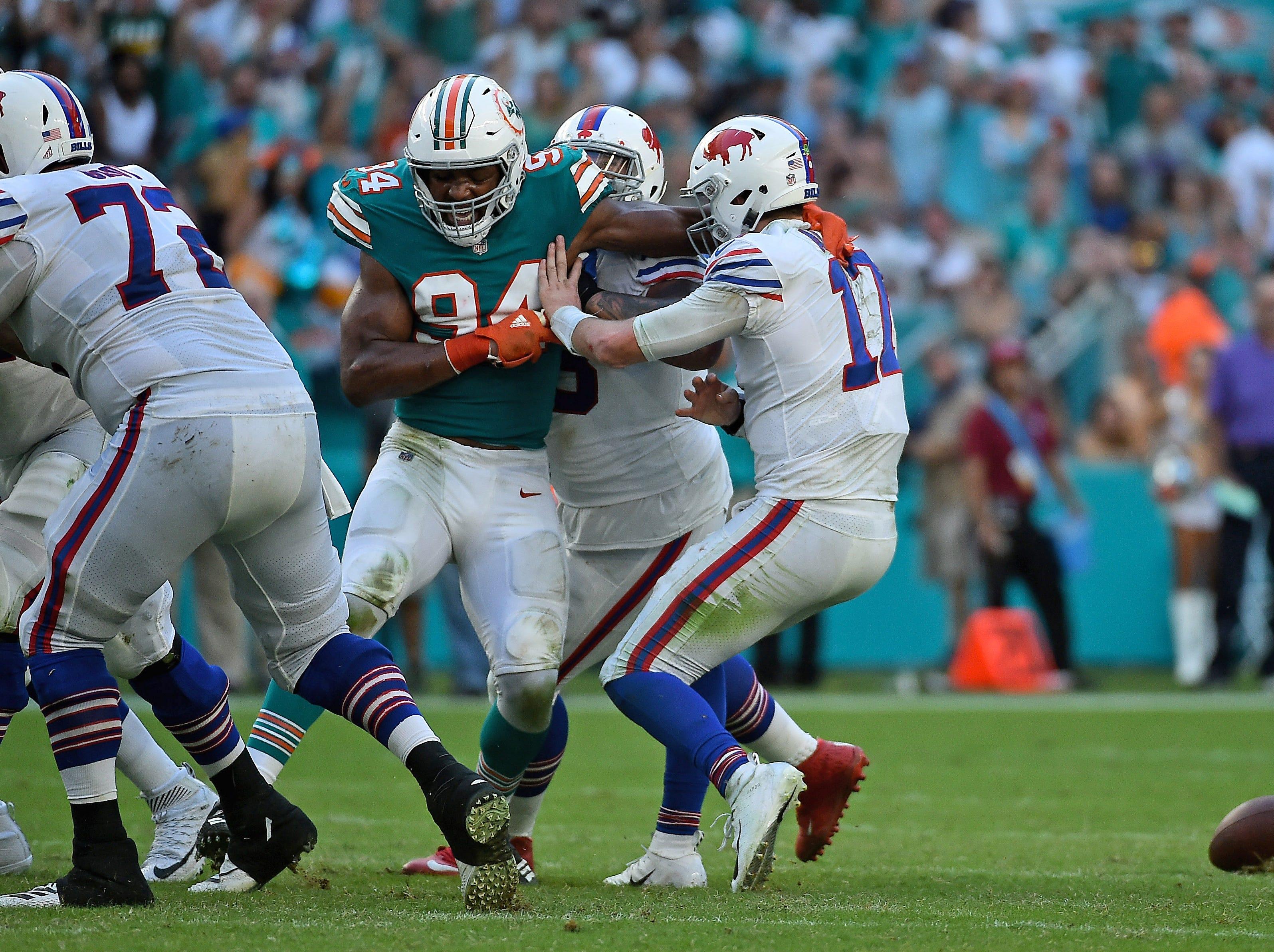 Dec 2, 2018; Miami Gardens, FL, USA; Miami Dolphins defensive end Robert Quinn (94) forces Buffalo Bills quarterback Josh Allen (17) to fumble the ball during the second half at Hard Rock Stadium. Mandatory Credit: Jasen Vinlove-USA TODAY Sports
