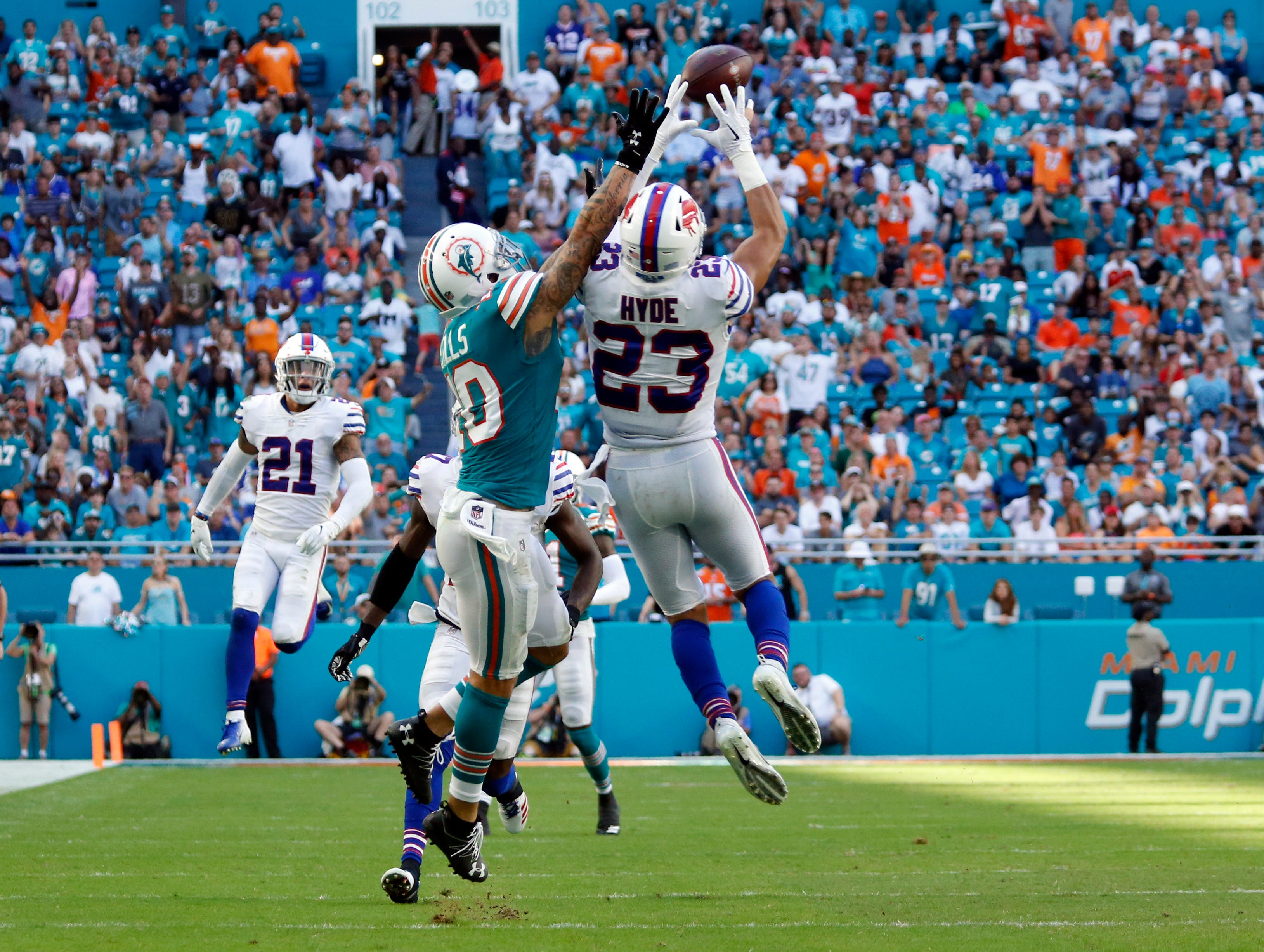 Buffalo Bills strong safety Micah Hyde (23) intercepts a pass intended for Miami Dolphins wide receiver Kenny Stills (10), during the second half of an NFL football game, Sunday, Dec. 2, 2018, in Miami Gardens, Fla. (AP Photo/Joel Auerbach)