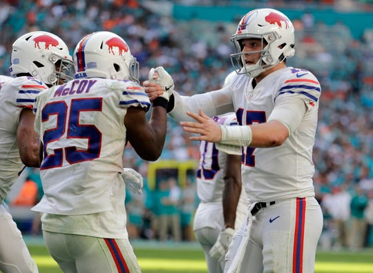 Buffalo Bills quarterback Josh Allen (17) celebrates a two-point conversion play with Buffalo Bills running back LeSean McCoy (25), during the second half of an NFL football game against the Miami Dolphins, Sunday, Dec. 2, 2018, in Miami Gardens, Fla. (AP Photo/Lynne Sladky)