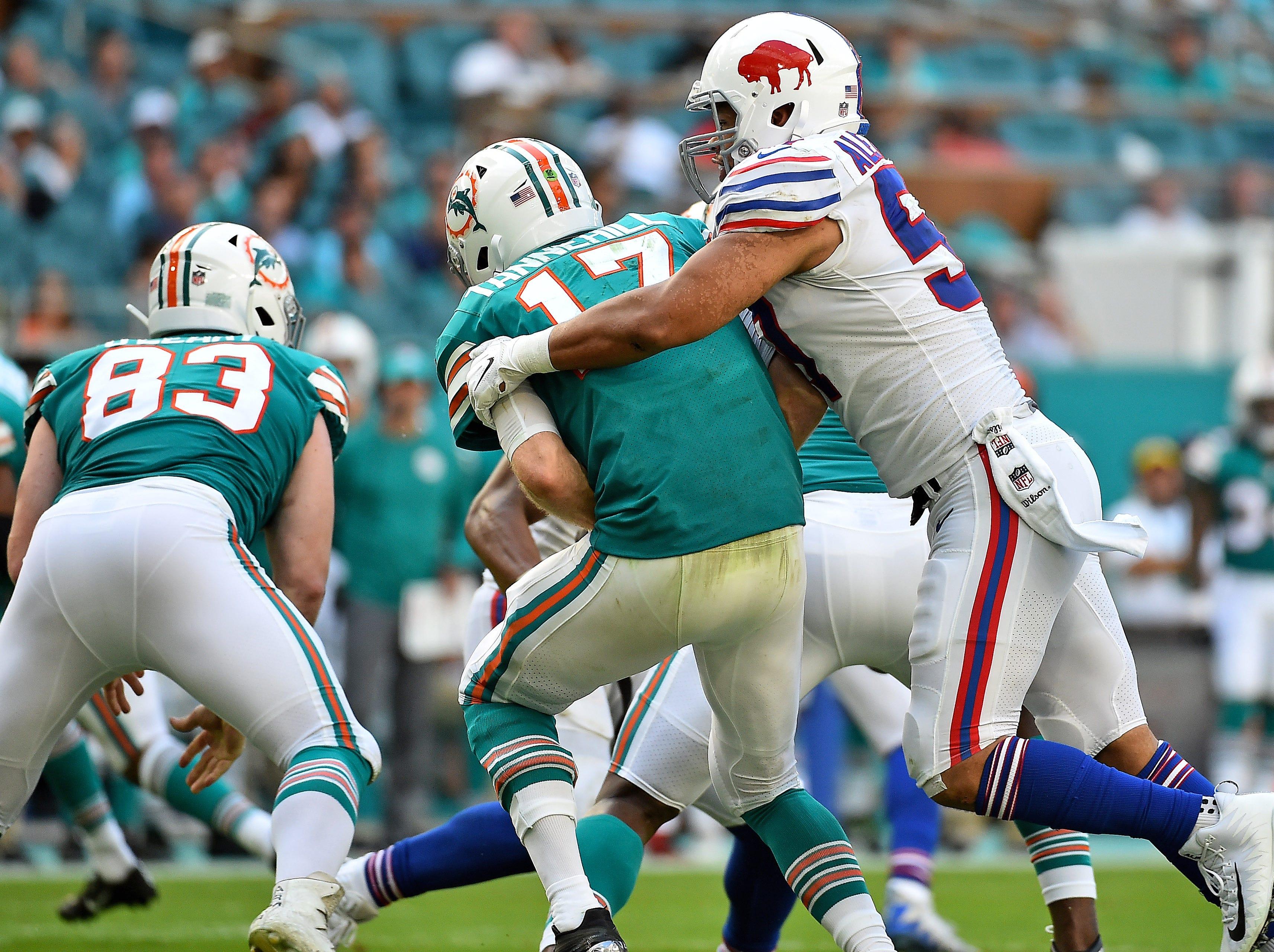 Dec 2, 2018; Miami Gardens, FL, USA; Buffalo Bills outside linebacker Lorenzo Alexander (57) sacks Miami Dolphins quarterback Ryan Tannehill (17) during the first half at Hard Rock Stadium. Mandatory Credit: Jasen Vinlove-USA TODAY Sports