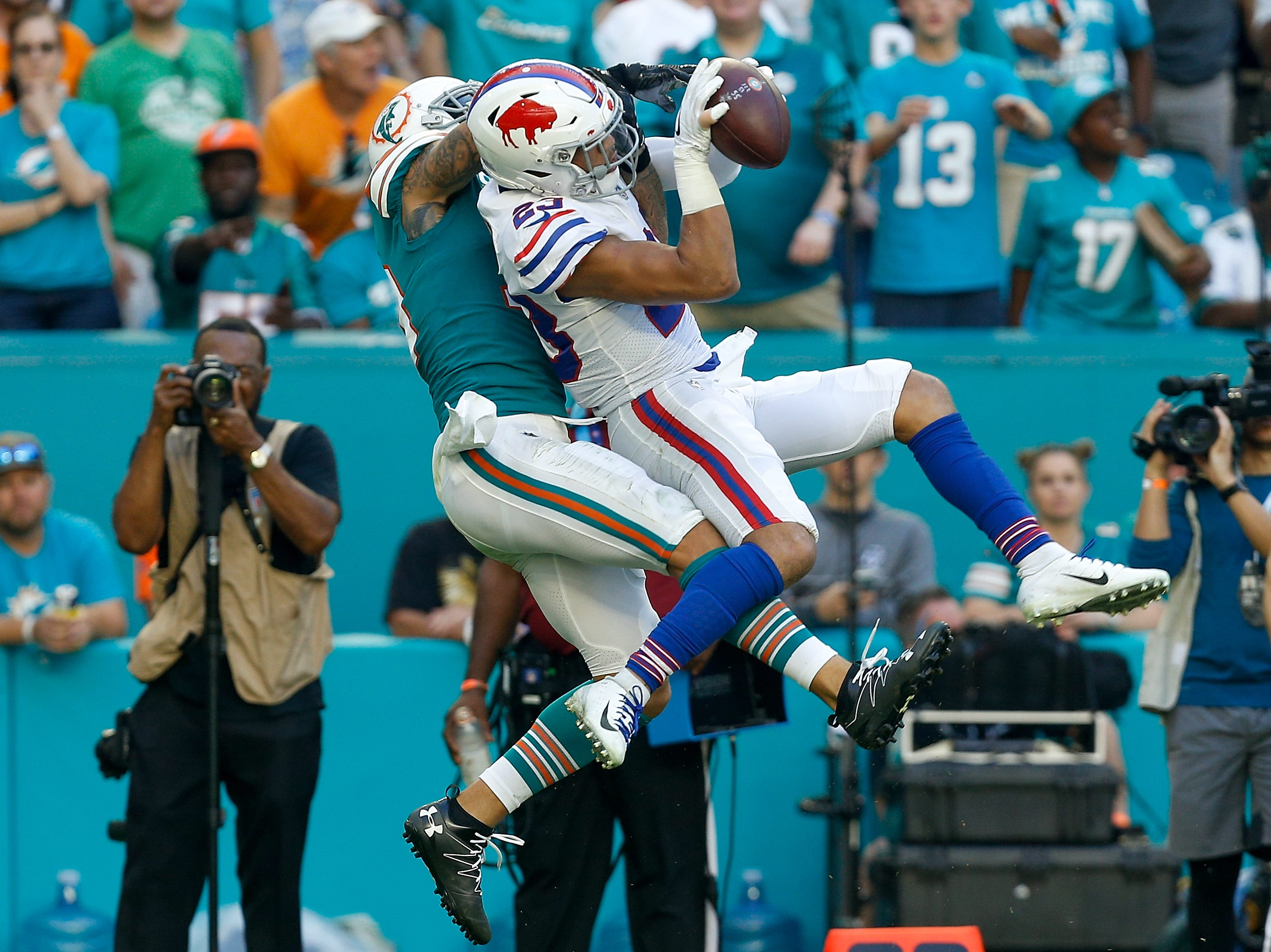 MIAMI, FL - DECEMBER 02: Micah Hyde #23 of the Buffalo Bills makes the catch for an interception (thrown by Ryan Tannehill #17 of the Miami Dolphins) during the second half against the Miami Dolphins at Hard Rock Stadium on December 2, 2018 in Miami, Florida.  (Photo by Michael Reaves/Getty Images)