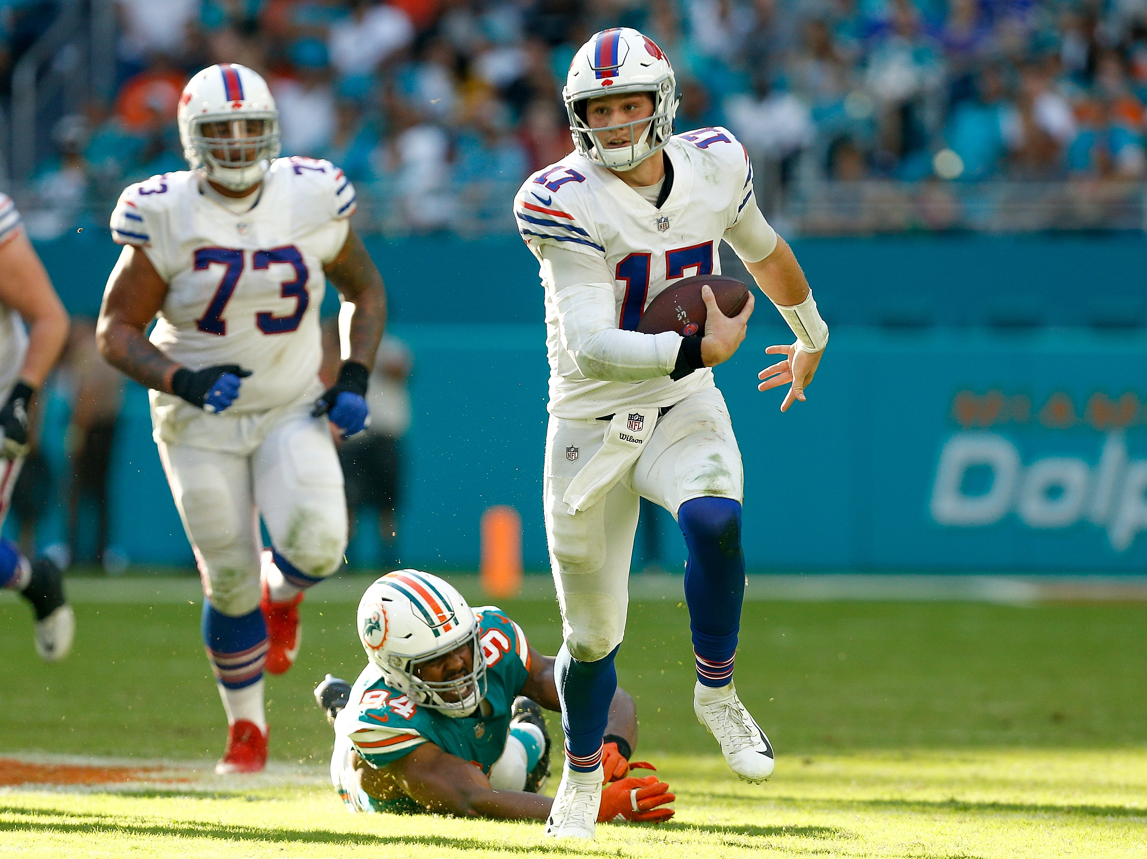 MIAMI, FL - DECEMBER 02:  Josh Allen #17 of the Buffalo Bills runs with the ball against the Miami Dolphins during the first half at Hard Rock Stadium on December 2, 2018 in Miami, Florida.  (Photo by Michael Reaves/Getty Images)