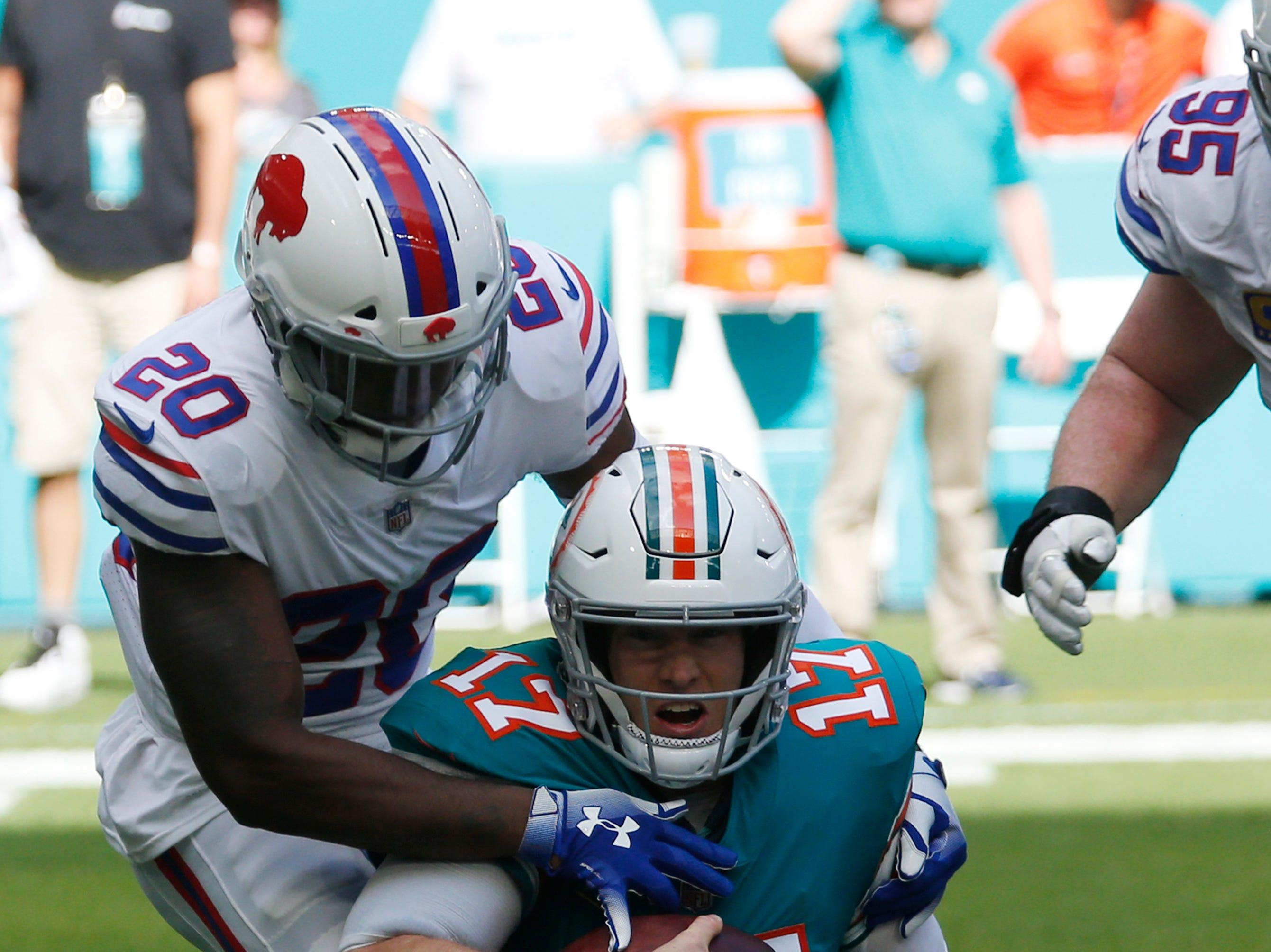 Miami Dolphins quarterback Ryan Tannehill (17) is sacked by Buffalo Bills defensive back Rafael Bush (20), during the first half of an NFL football game, Sunday, Dec. 2, 2018, in Miami Gardens, Fla. (AP Photo/Joel Auerbach)