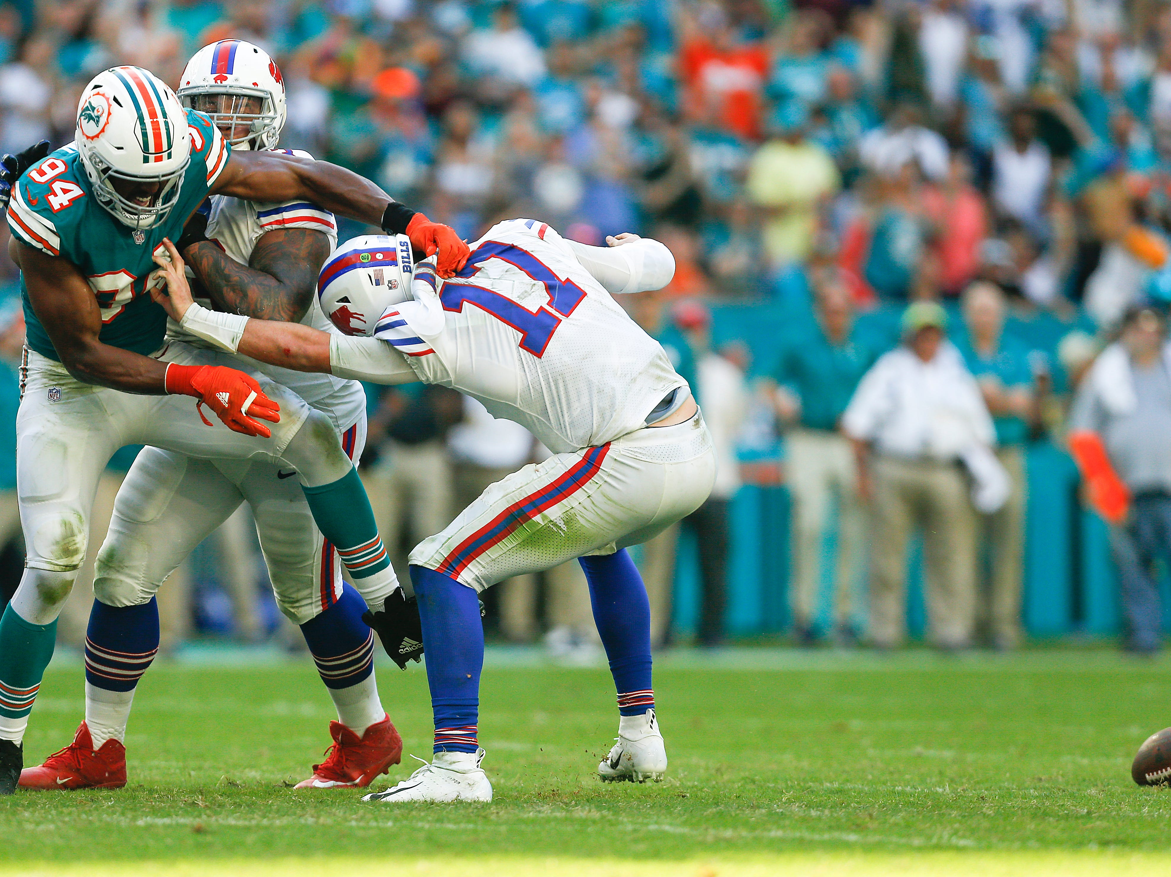 MIAMI, FL - DECEMBER 02:  Robert Quinn #94 of the Miami Dolphins forces Josh Allen #17 of the Buffalo Bills to fumble during the second half at Hard Rock Stadium on December 2, 2018 in Miami, Florida.  (Photo by Michael Reaves/Getty Images)