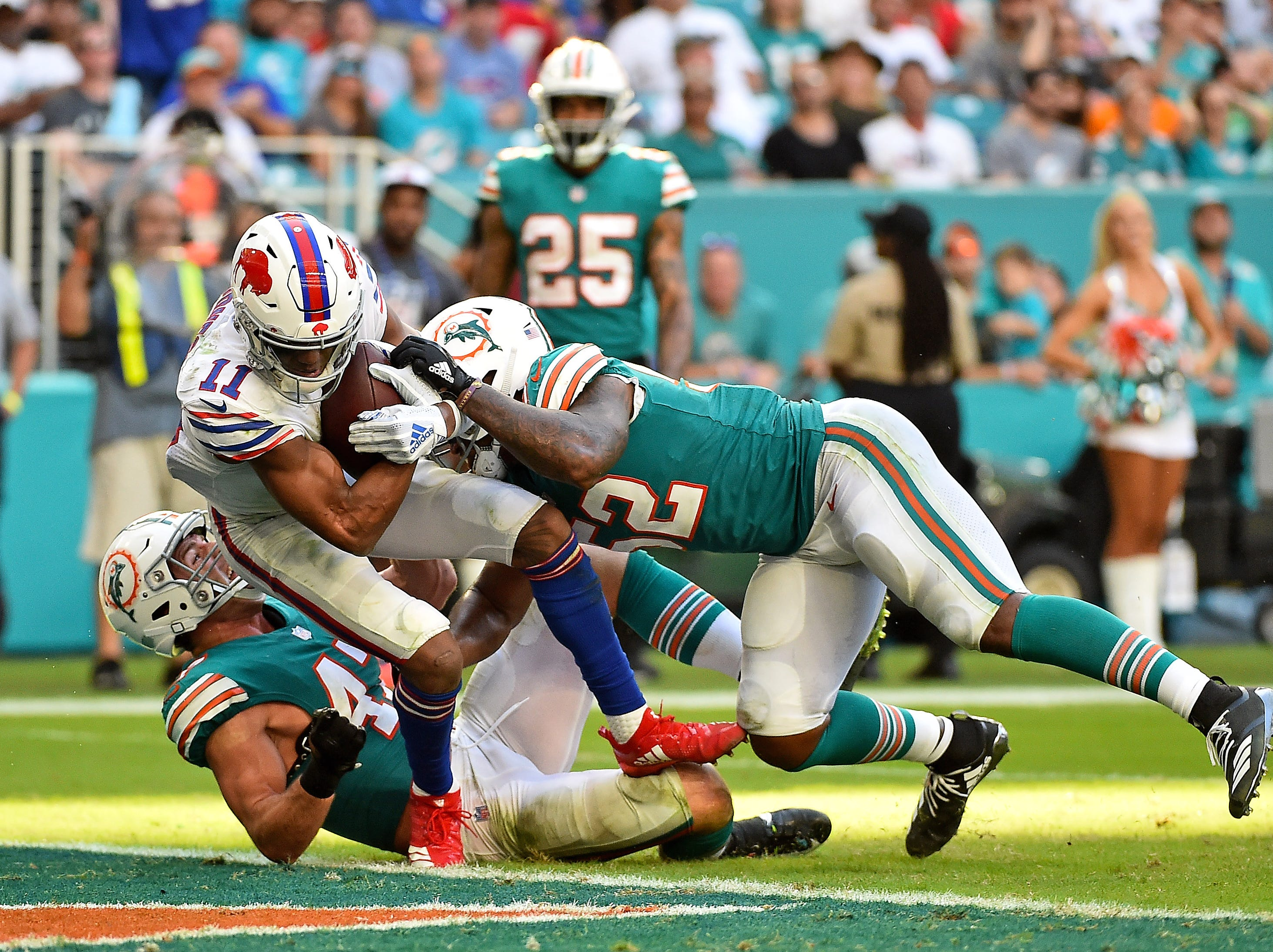Dec 2, 2018; Miami Gardens, FL, USA; Buffalo Bills wide receiver Zay Jones (11) is brought down in the end zone to score a touchdown against the Miami Dolphins during the second half at Hard Rock Stadium. Mandatory Credit: Jasen Vinlove-USA TODAY Sports