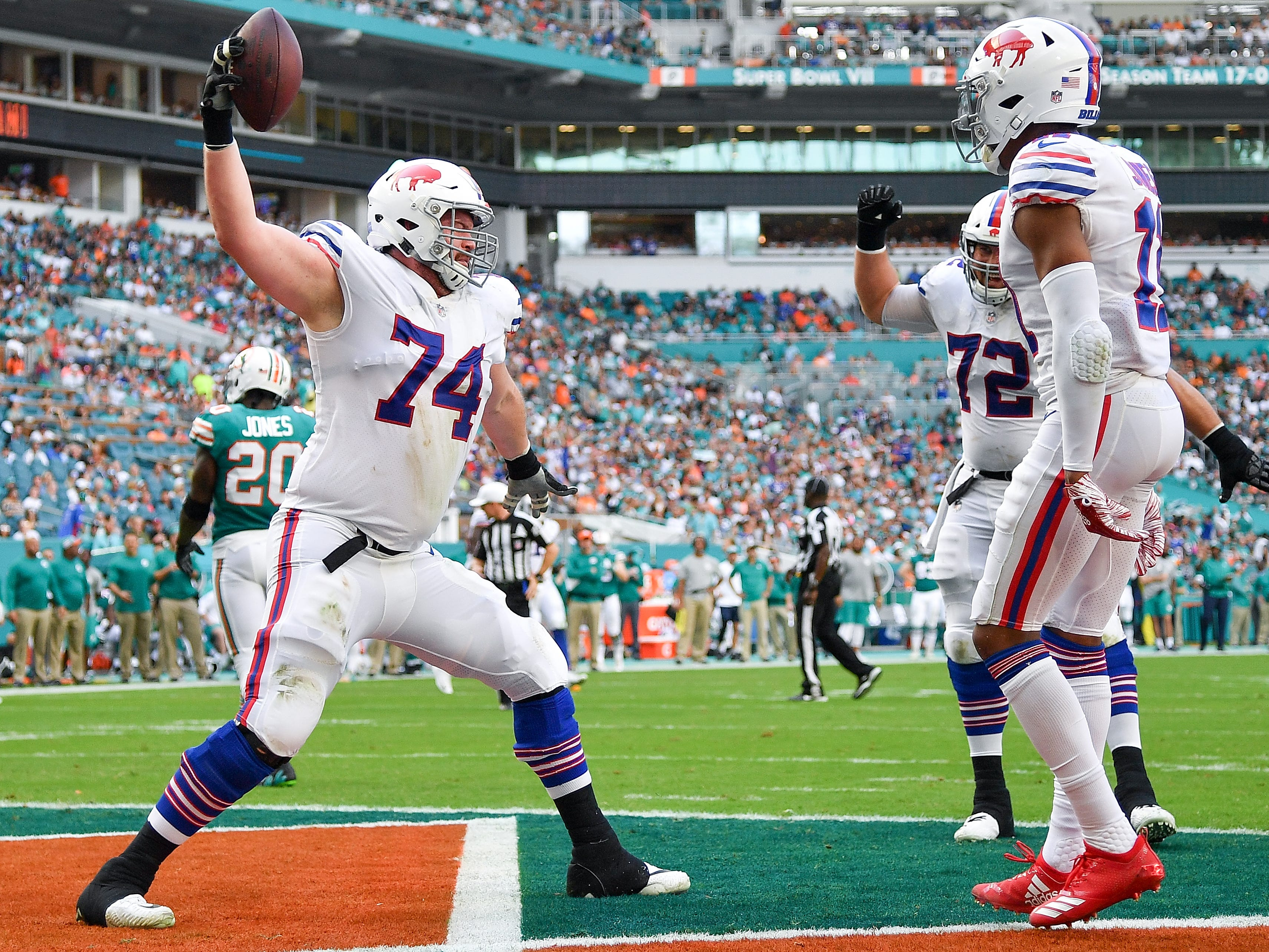 MIAMI, FL - DECEMBER 02: Jeremiah Sirles #74 of the Buffalo Bills celebrates after a touchdown during the second quarter against the Miami Dolphins at Hard Rock Stadium on December 2, 2018 in Miami, Florida. (Photo by Mark Brown/Getty Images)