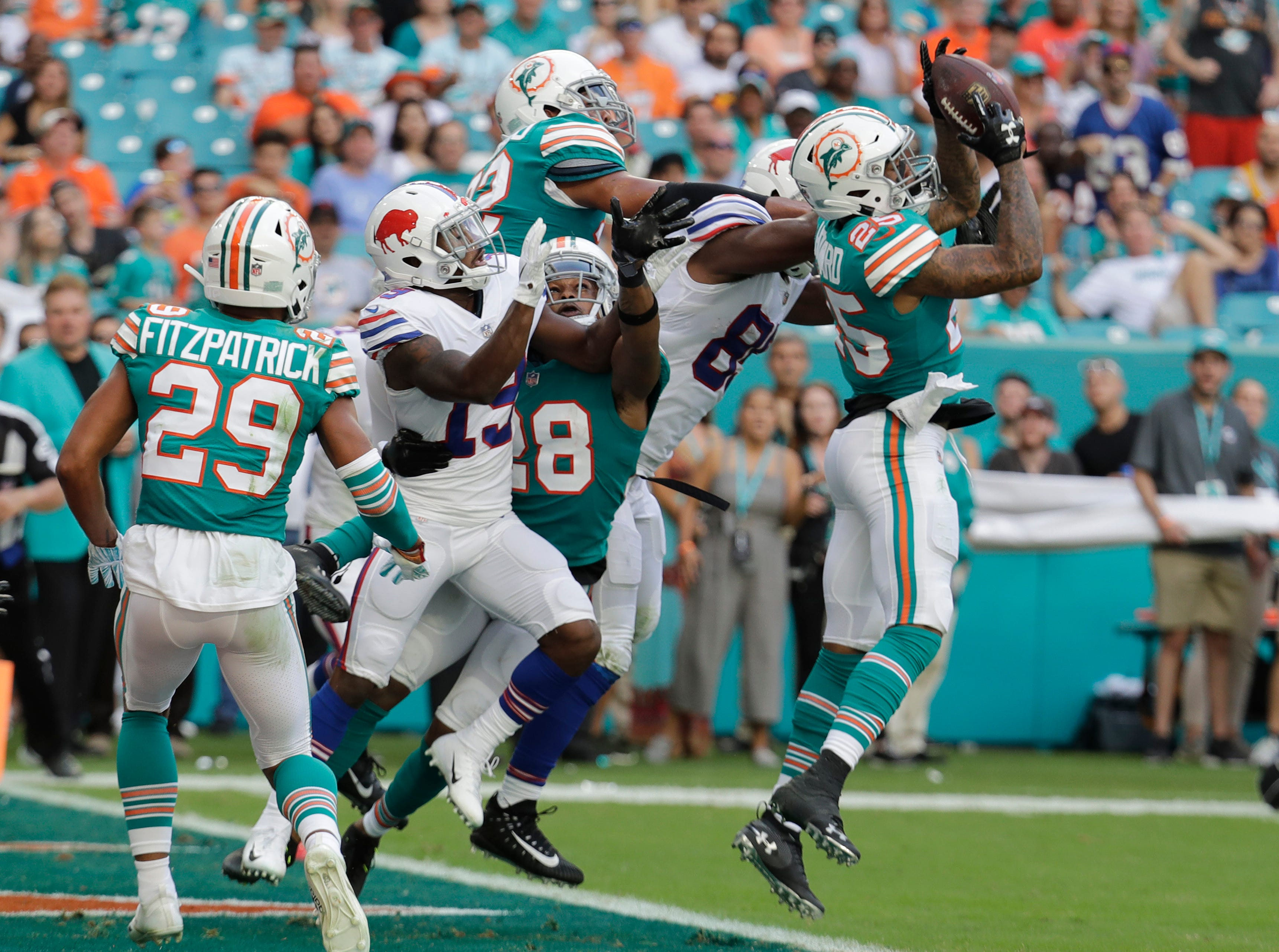Miami Dolphins cornerback Xavien Howard (25) intercepts a long pass in the enzone, during the first half of an NFL football game against the Buffalo Bills, Sunday, Dec. 2, 2018, in Miami Gardens, Fla (AP Photo/Lynne Sladky)