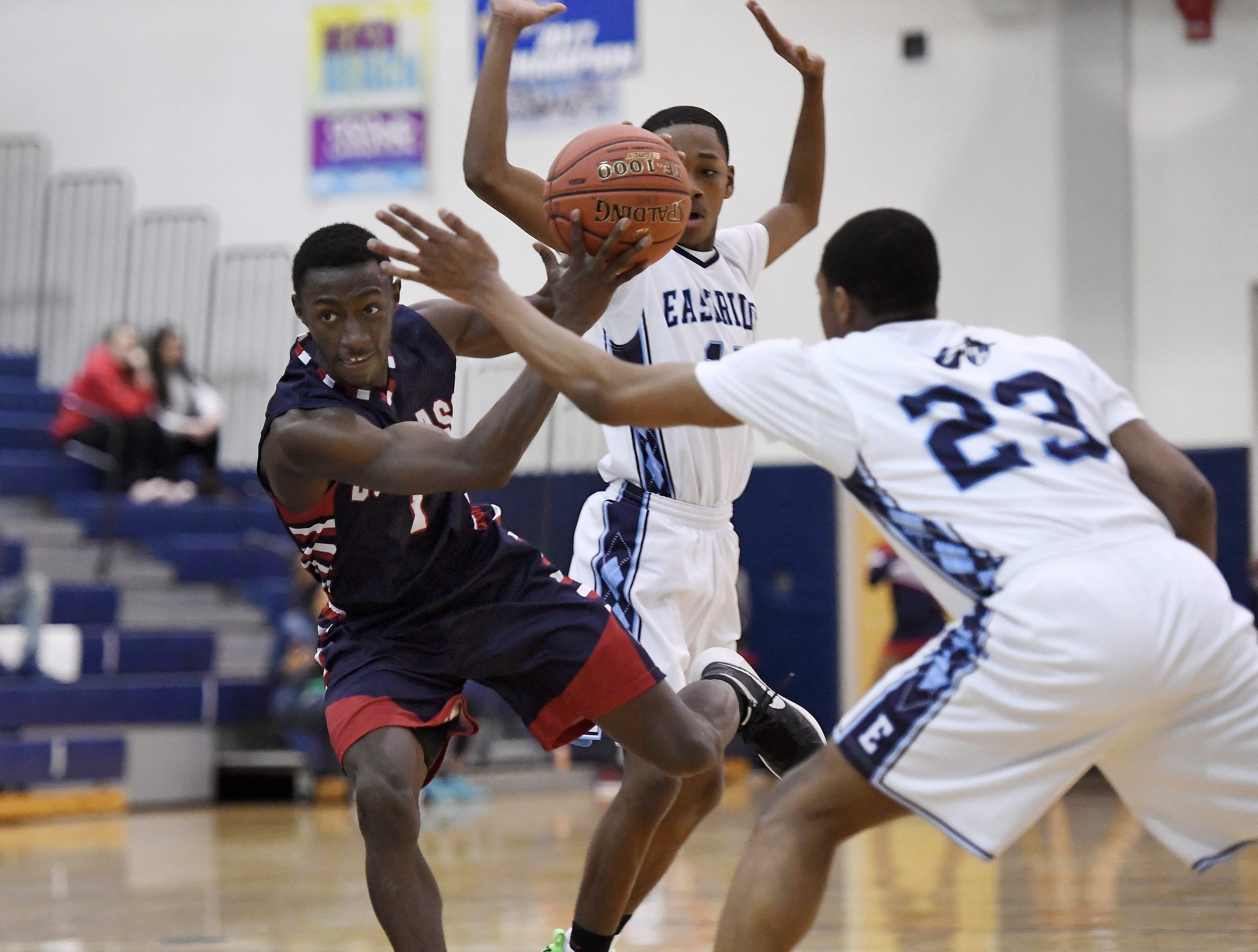 NE Douglass' Maurice Glenn tries to keep control of ball during the finals of the Al Masino Memorial Tip-Off Tournament at Eastridge High School.