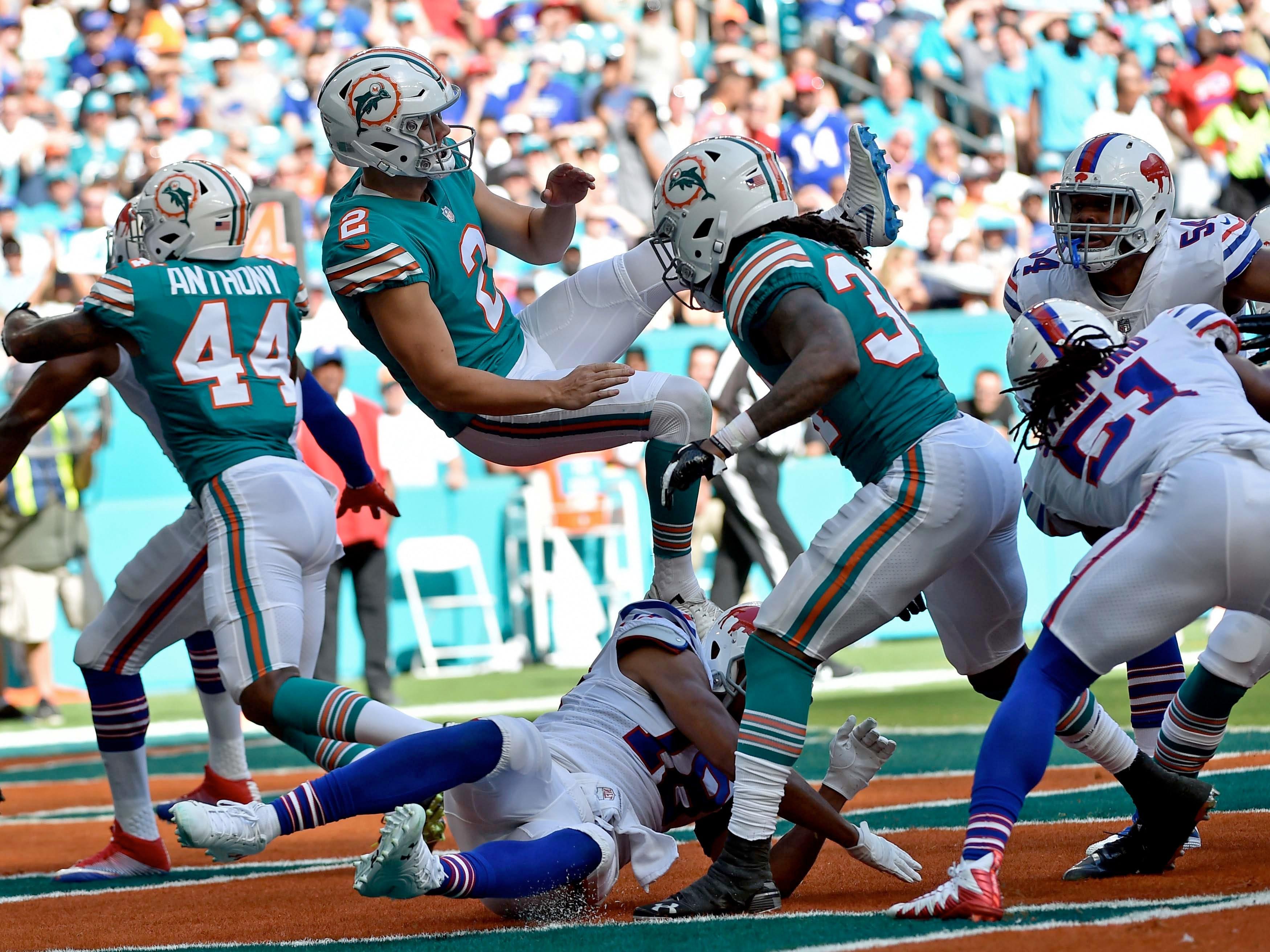 Dec 2, 2018; Miami Gardens, FL, USA; Buffalo Bills wide receiver Andre Holmes (18) runs into Miami Dolphins punter Matt Haack (2) during the first half at Hard Rock Stadium. Mandatory Credit: Steve Mitchell-USA TODAY Sports