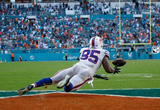 Buffalo Bills tight end Charles Clay (85) is unable to catch a last minute catch in the end zone, during the second half of an NFL football game against the Miami Dolphins, Sunday, Dec. 2, 2018, in Miami Gardens, Fla. The Dolphins defeated the Bills 21-17. (AP Photo/Joel Auerbach)