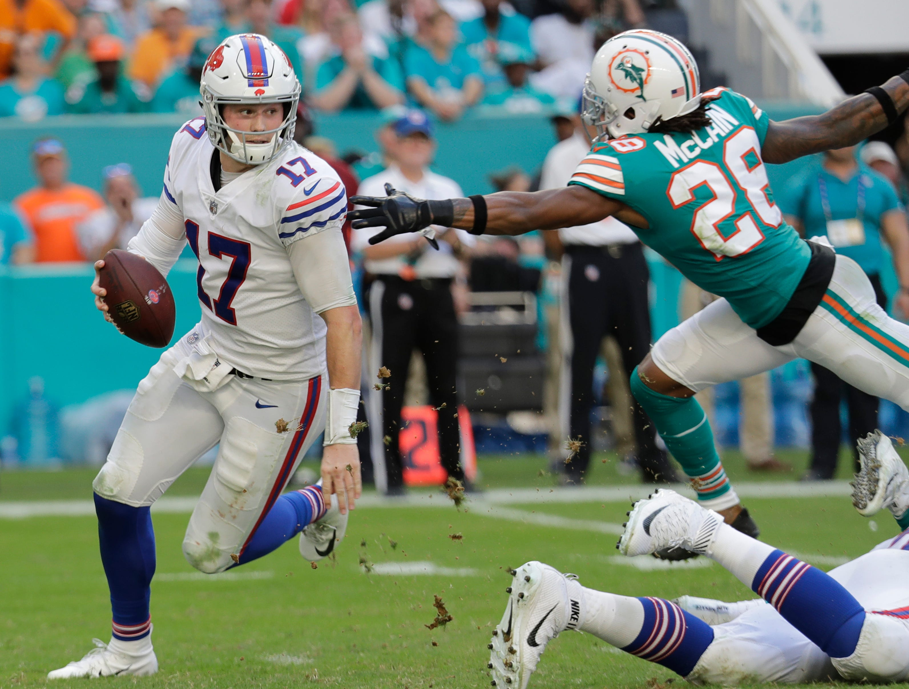 Buffalo Bills quarterback Josh Allen (17) avoids a tackle by Miami Dolphins cornerback Bobby McCain (28), during the second half of an NFL football game, Sunday, Dec. 2, 2018, in Miami Gardens, Fla(AP Photo/Lynne Sladky)