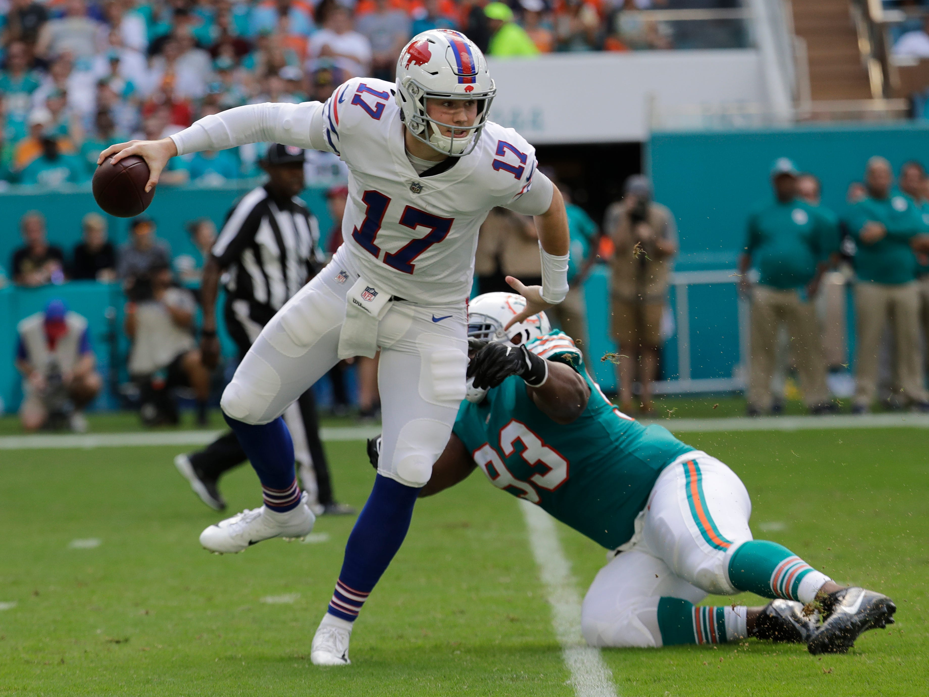 Buffalo Bills quarterback Josh Allen (17) avoids a tackle by Miami Dolphins defensive tackle Akeem Spence (93), during the first half of an NFL football game, Sunday, Dec. 2, 2018, in Miami Gardens, Fla. (AP Photo/Lynne Sladky)
