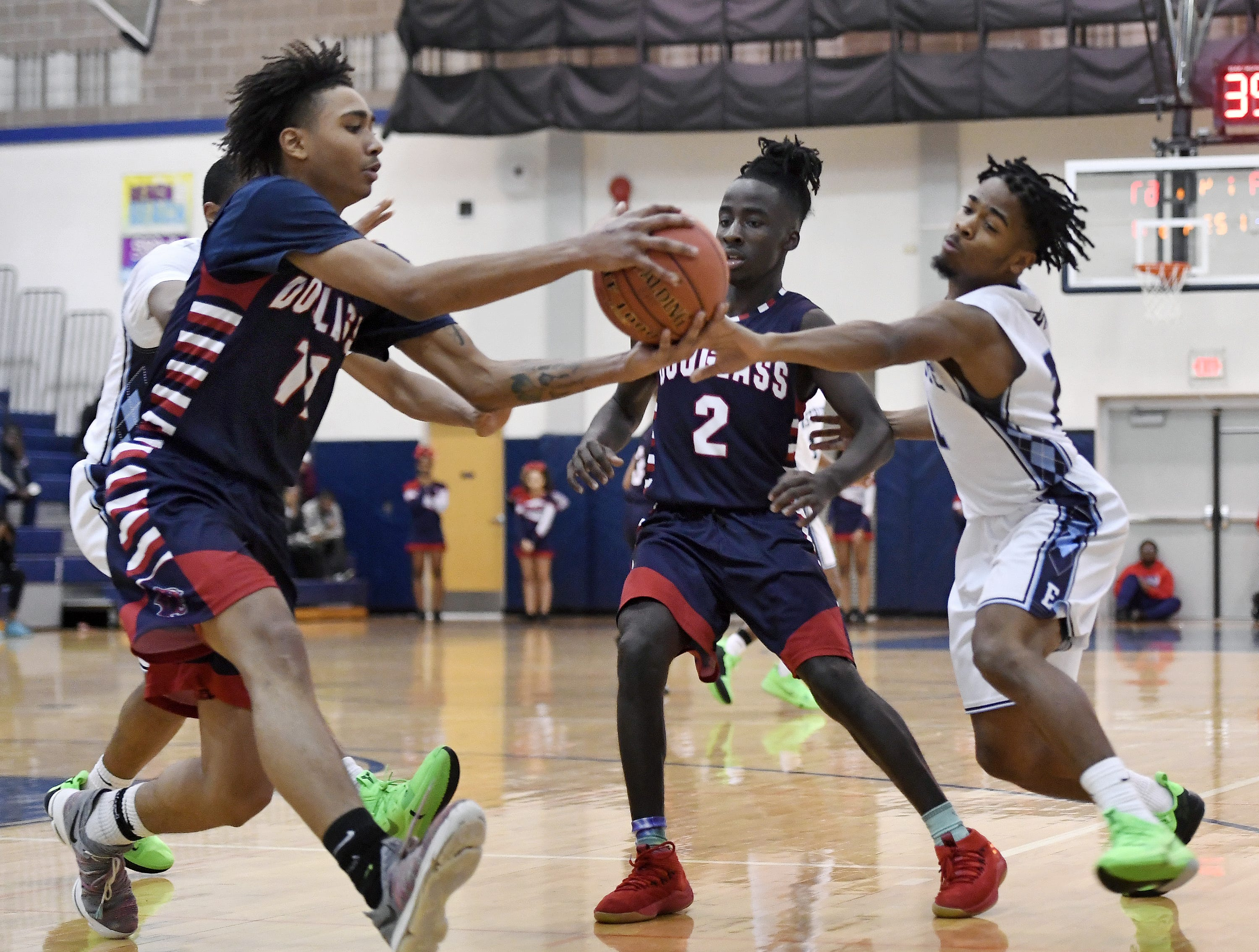 Eastridge's Adrian Rodgers, right, tries to steal an inbounded ball for NE Douglass' Adonis Flagler during the finals of the Al Masino Memorial Tip-Off Tournament.