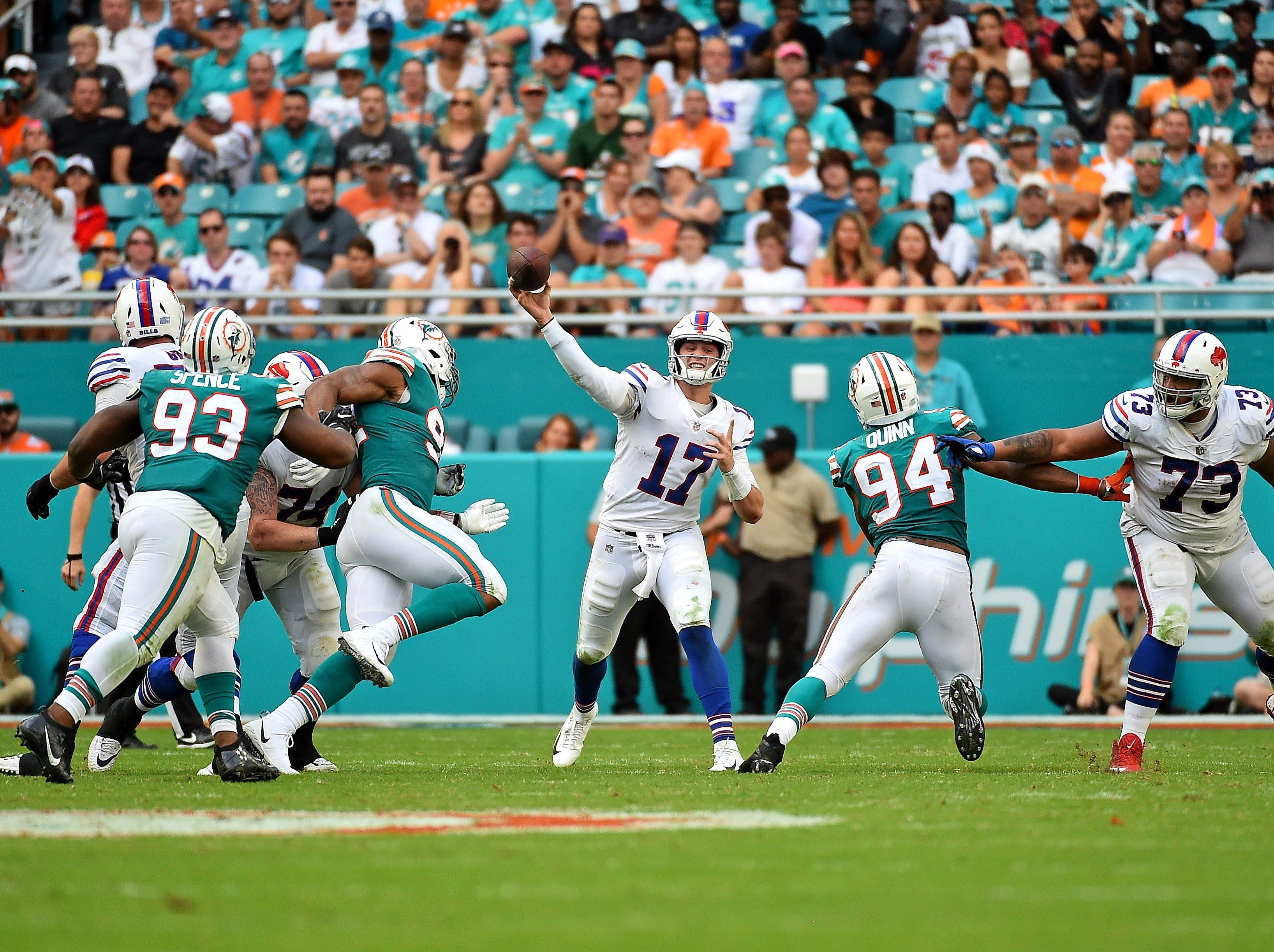 Dec 2, 2018; Miami Gardens, FL, USA; Buffalo Bills quarterback Josh Allen (17) attempts a pass against the Miami Dolphins during the first half at Hard Rock Stadium. Mandatory Credit: Jasen Vinlove-USA TODAY Sports