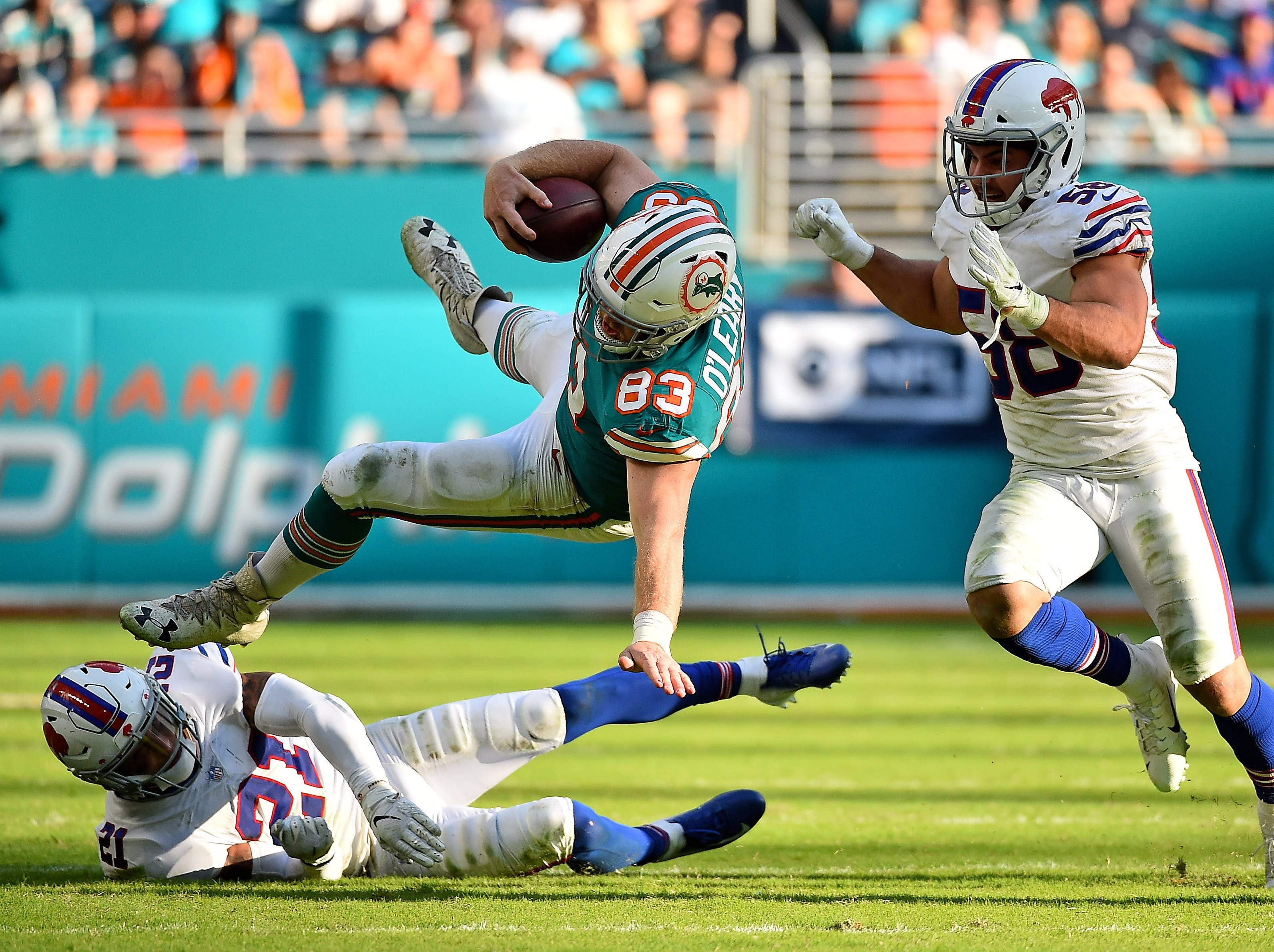 Dec 2, 2018; Miami Gardens, FL, USA; Buffalo Bills free safety Jordan Poyer (21) upends Miami Dolphins tight end Nick O'Leary (83) during the second half at Hard Rock Stadium. Mandatory Credit: Jasen Vinlove-USA TODAY Sports