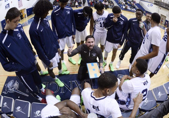 Eastridge head coach Dan Roser talks to his team in a timeout during the finals of the Al Masino Memorial Tip-Off Tournament.