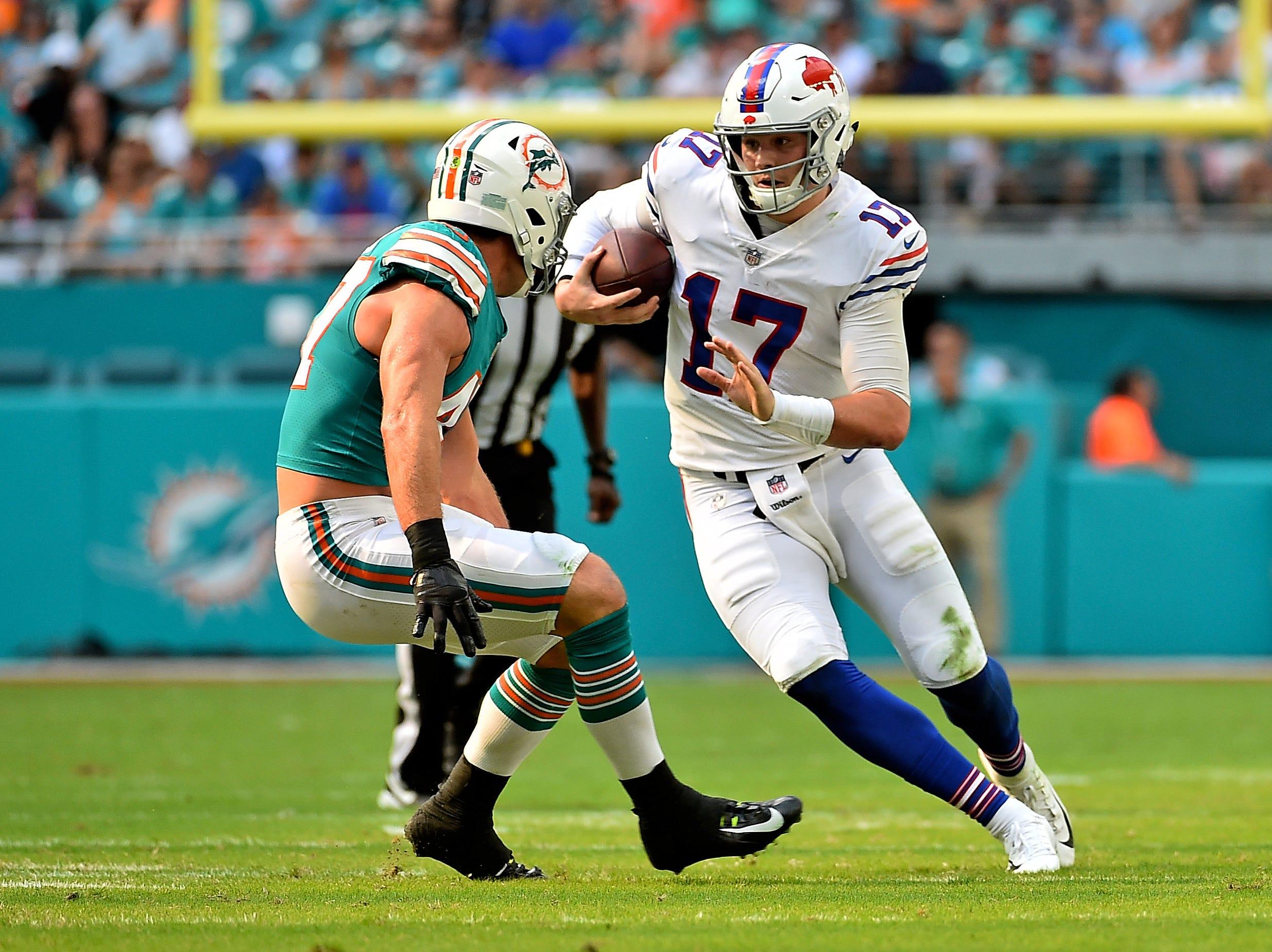 Dec 2, 2018; Miami Gardens, FL, USA; Buffalo Bills quarterback Josh Allen (17) scrambles around Miami Dolphins outside linebacker Kiko Alonso (47) during the first half at Hard Rock Stadium. Mandatory Credit: Jasen Vinlove-USA TODAY Sports