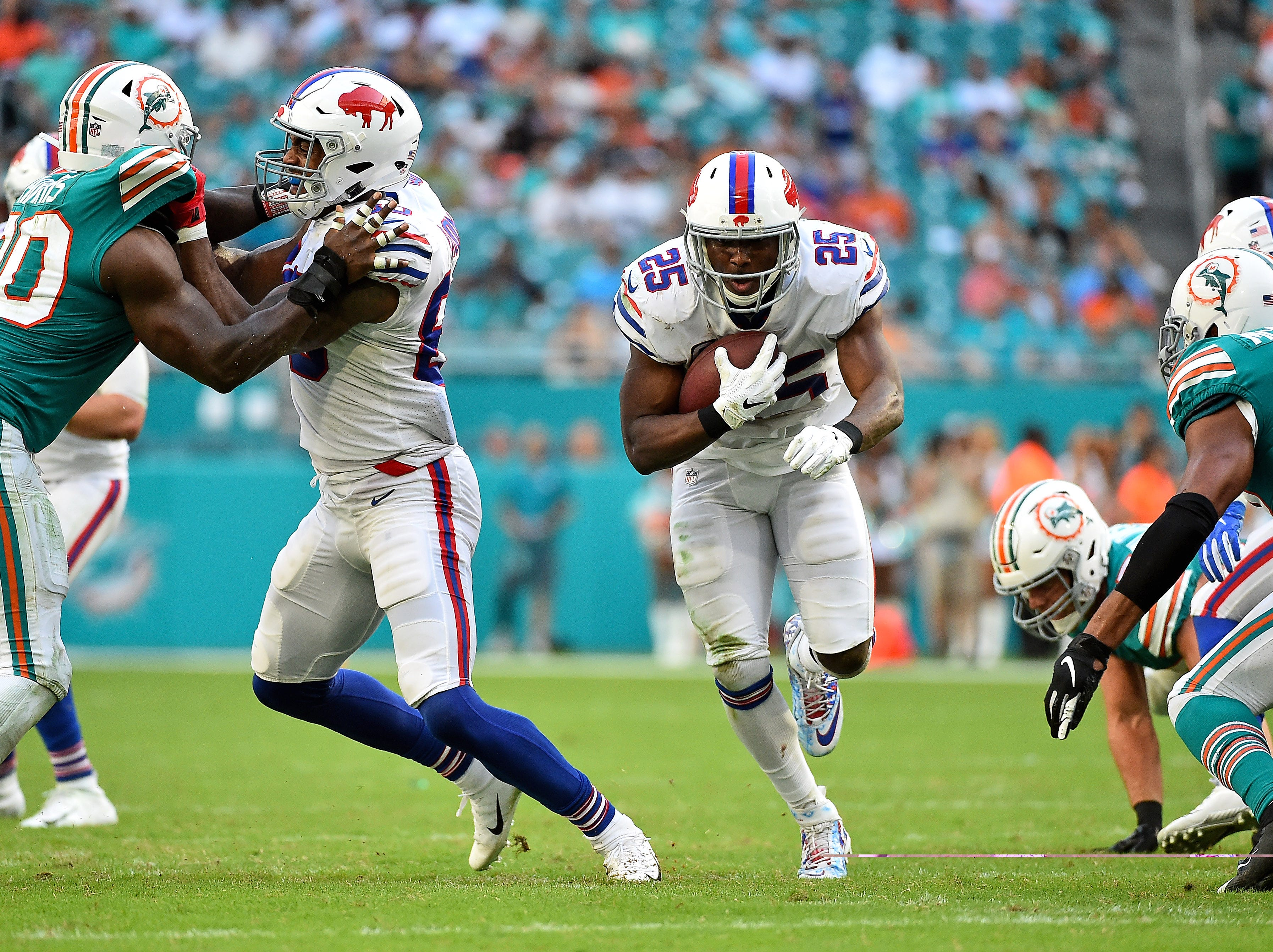 Dec 2, 2018; Miami Gardens, FL, USA; Buffalo Bills running back LeSean McCoy (25) carries the ball against the Miami Dolphins during the second half at Hard Rock Stadium. Mandatory Credit: Jasen Vinlove-USA TODAY Sports