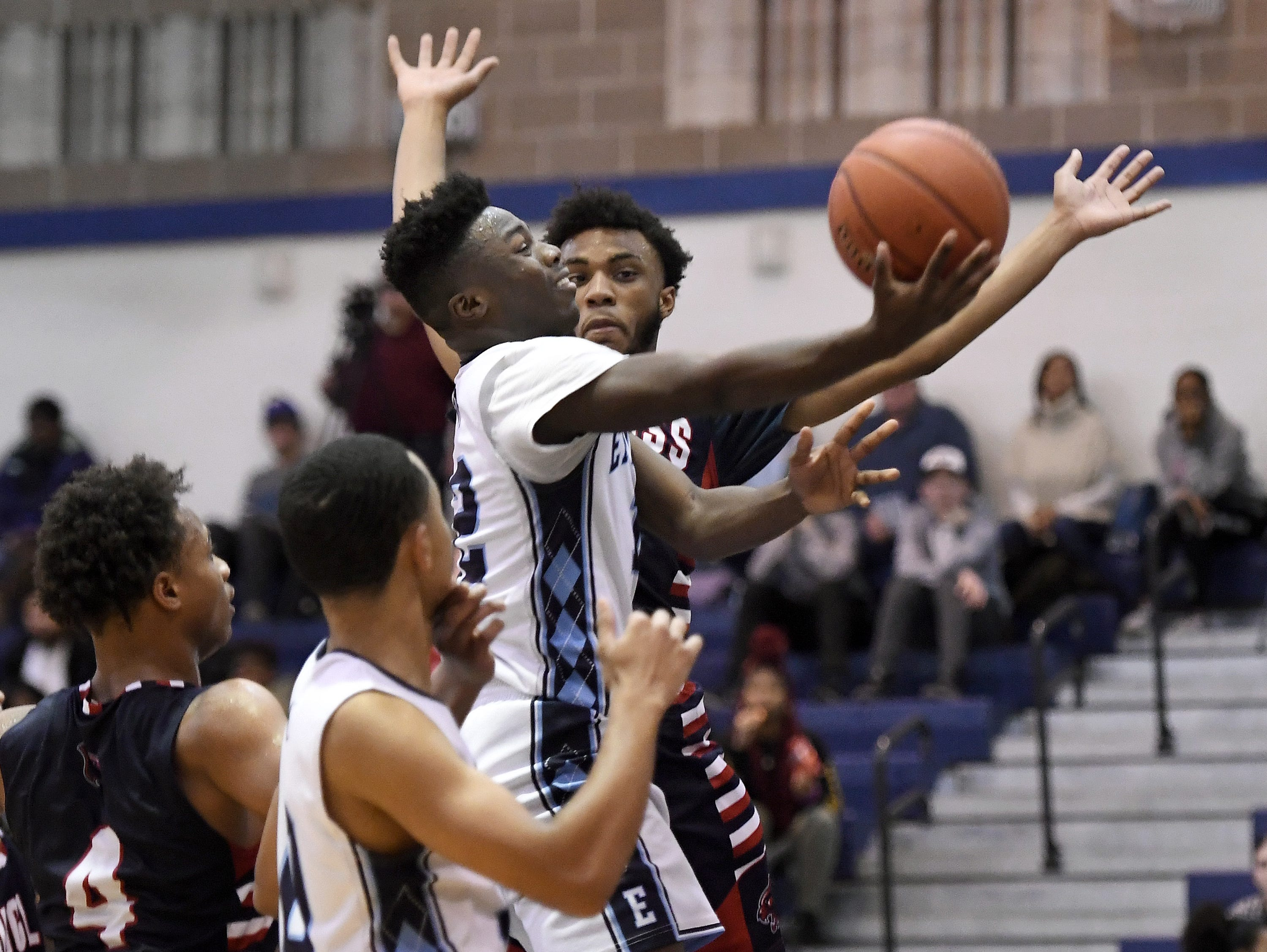 Eastridge's Jalen Rose Hannah drives to the hoop in front of NE Douglass' Nicolas Jeanty during the finals of the Al Masino Memorial Tip-Off Tournament.