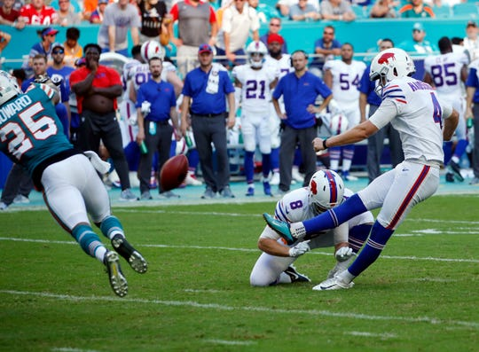 Buffalo Bills kicker Stephen Hauschka (4) kicks a field goal as punter Matt Darr (8) holds, during the second half of an NFL football game against the Miami Dolphins, Sunday, Dec. 2, 2018, in Miami Gardens, Fla. (AP Photo/Joel Auerbach)