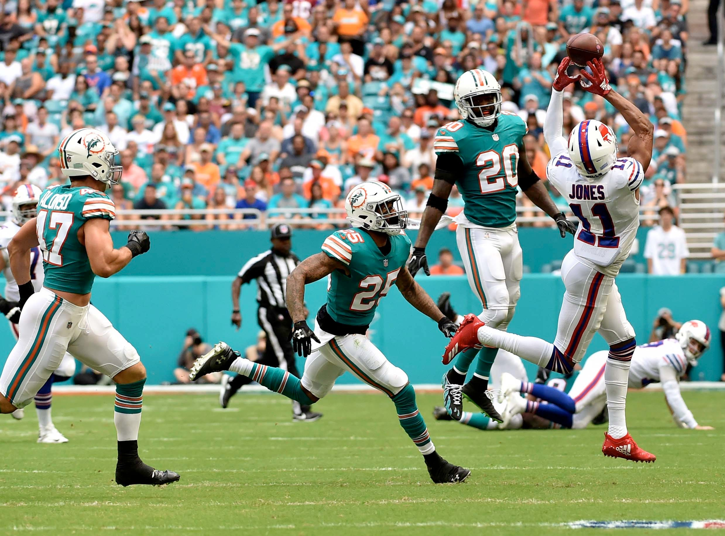 Dec 2, 2018; Miami Gardens, FL, USA; Buffalo Bills wide receiver Zay Jones (11) is unable to make a catch as Miami Dolphins free safety Reshad Jones (20) looks on during the first half at Hard Rock Stadium. Mandatory Credit: Steve Mitchell-USA TODAY Sports