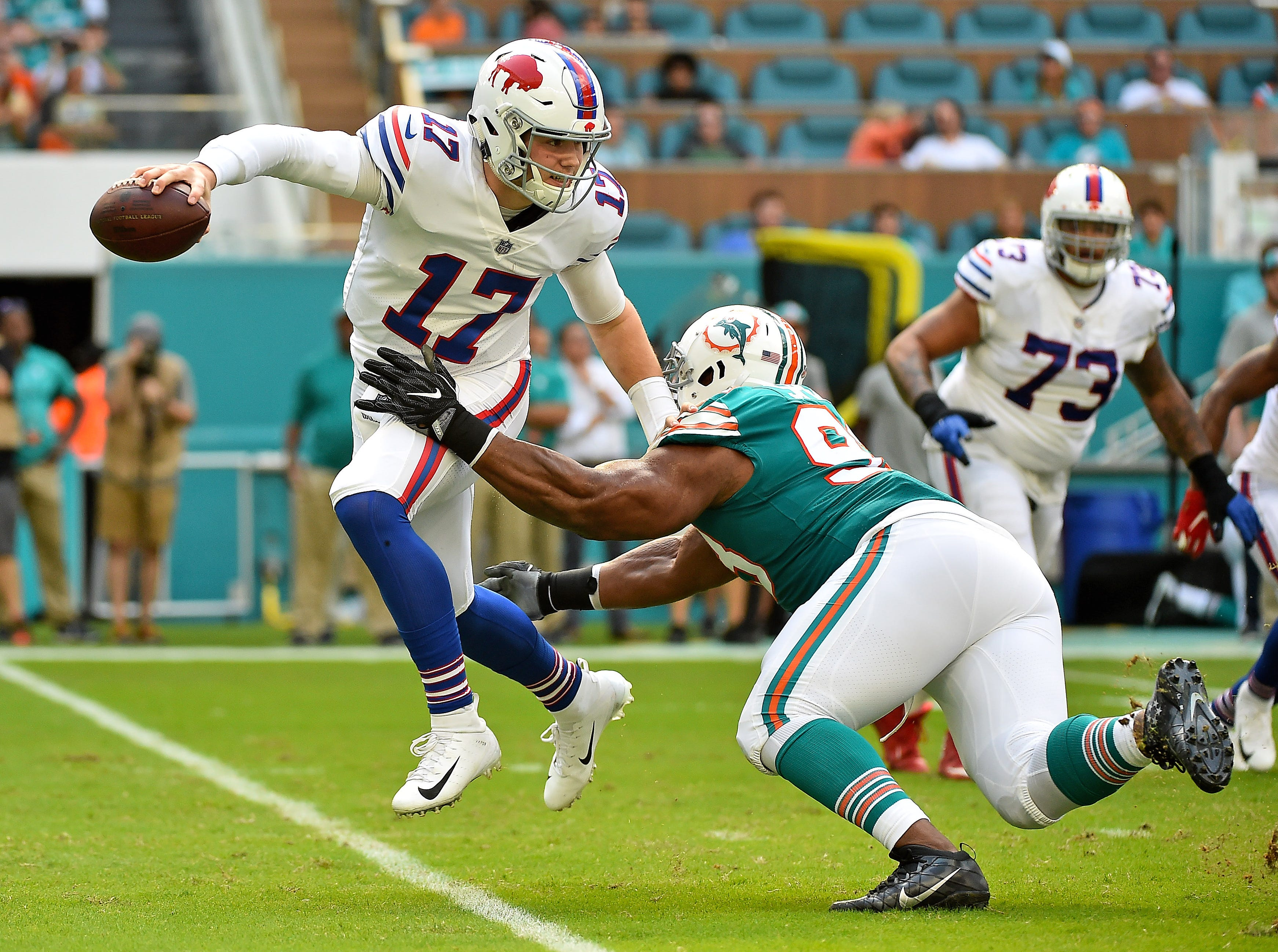 Dec 2, 2018; Miami Gardens, FL, USA; Miami Dolphins defensive tackle Akeem Spence (93) pressures Buffalo Bills quarterback Josh Allen (17) during the first half at Hard Rock Stadium. Mandatory Credit: Jasen Vinlove-USA TODAY Sports