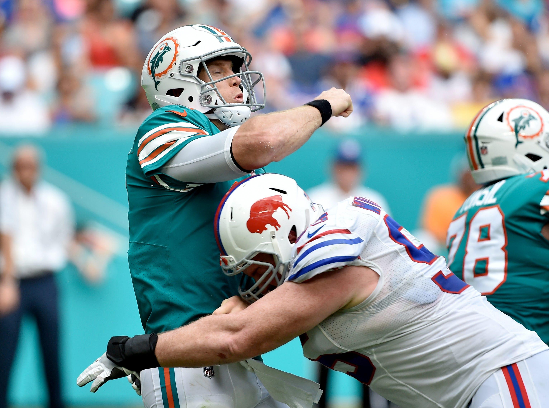 Dec 2, 2018; Miami Gardens, FL, USA; Buffalo Bills defensive tackle Kyle Williams (95) hits Miami Dolphins quarterback Ryan Tannehill (17) during the first half at Hard Rock Stadium. Mandatory Credit: Steve Mitchell-USA TODAY Sports