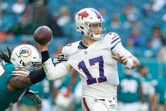 MIAMI, FL - DECEMBER 02:  Josh Allen #17 of the Buffalo Bills throws a pass under pressure from Ziggy Hood #97 of the Miami Dolphins during the second half at Hard Rock Stadium on December 2, 2018 in Miami, Florida.  (Photo by Michael Reaves/Getty Images)