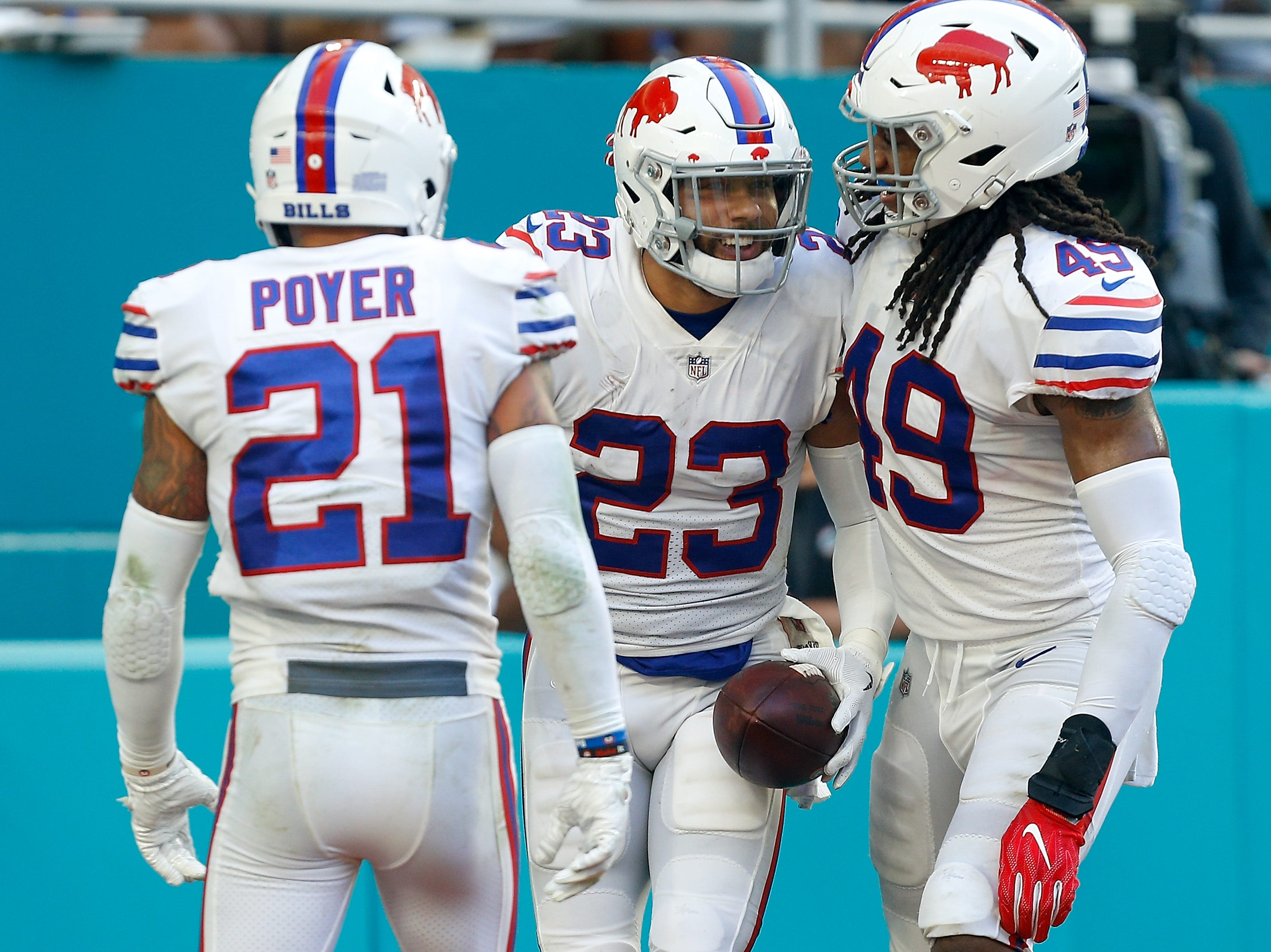 MIAMI, FL - DECEMBER 02: Micah Hyde #23 of the Buffalo Bills celebrates with teammate after making the interception during the second half against the Miami Dolphins at Hard Rock Stadium on December 2, 2018 in Miami, Florida.  (Photo by Michael Reaves/Getty Images)